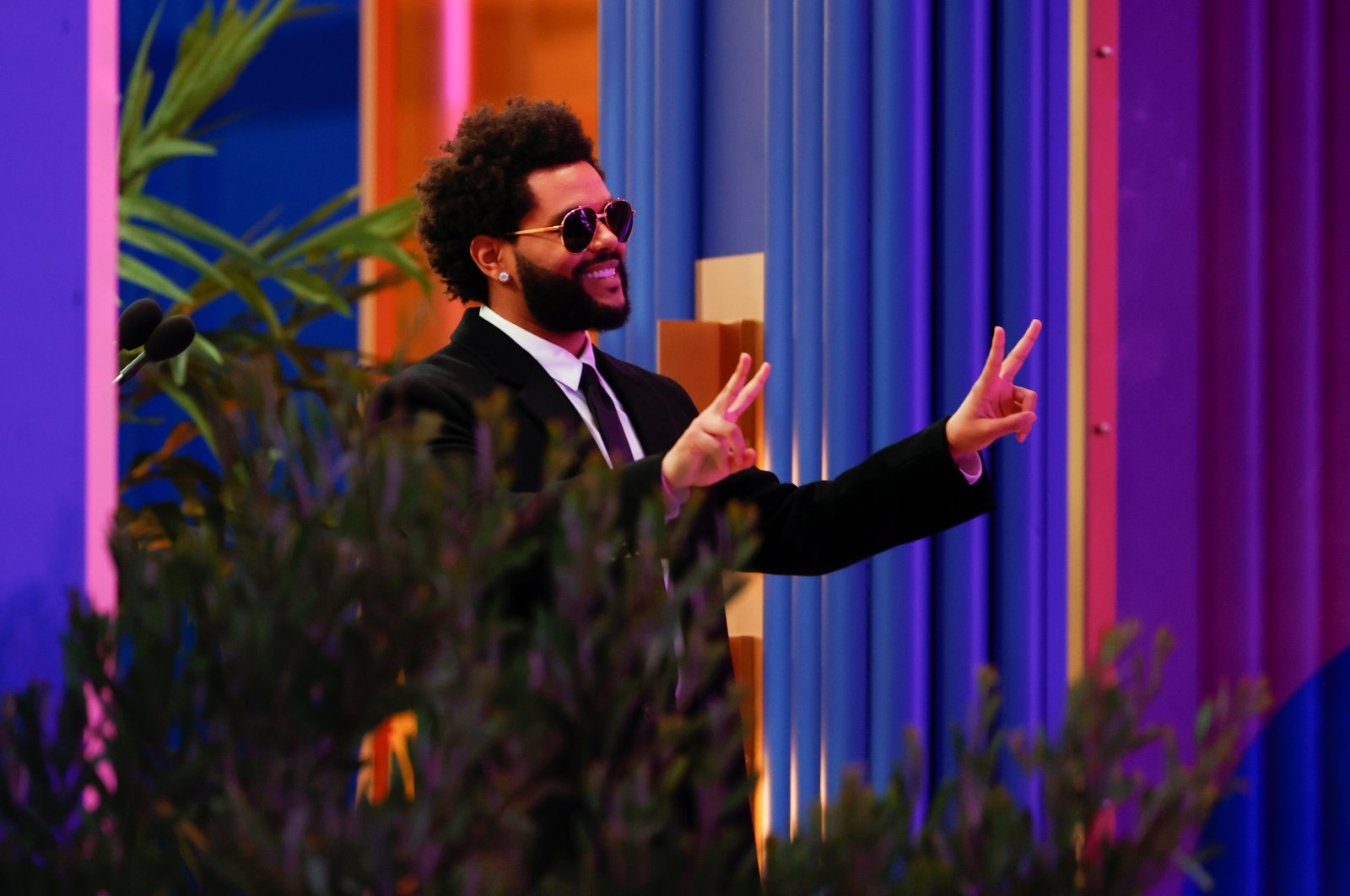 The Weeknd gestures as he accepts the award for Top Artist at the 2021 Billboard Music Awards outside the Microsoft Theater in Los Angeles, California, U.S. May 23, 2021. (REUTERS Photo)