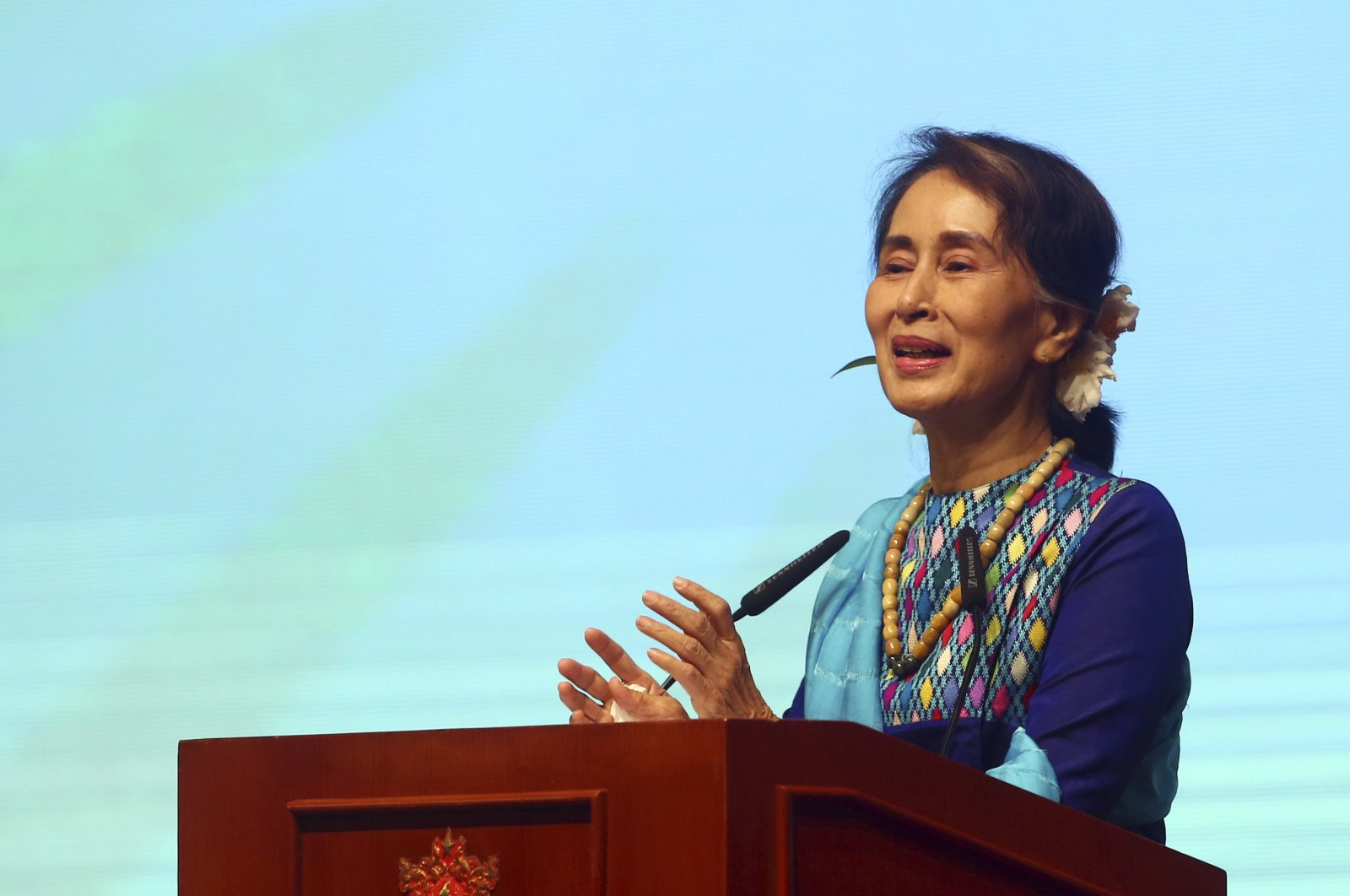 Myanmar's Leader Aung San Suu Kyi smiles as she delivers a speech during the meeting with the country's business leaders at the Myanmar International Convention Center in Naypyitaw, Myanmar, Monday, Aug. 27, 2018. (AP Photo)