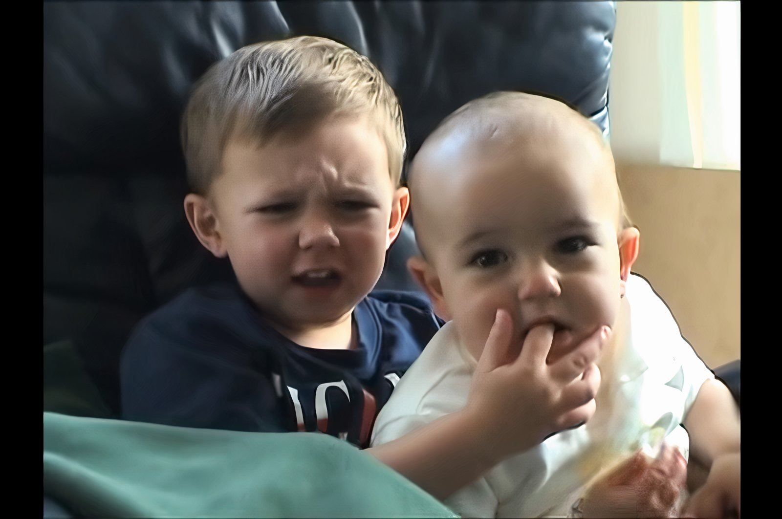 """Charlie, 1, bites the finger of his older brother Harry, 3, as seen from the screenshot of a homevideo uploaded to the social media platform YouTube by the channel """"HDCYT"""" on May 22, 2007. (Courtesy of YouTube's HDCYT)"""