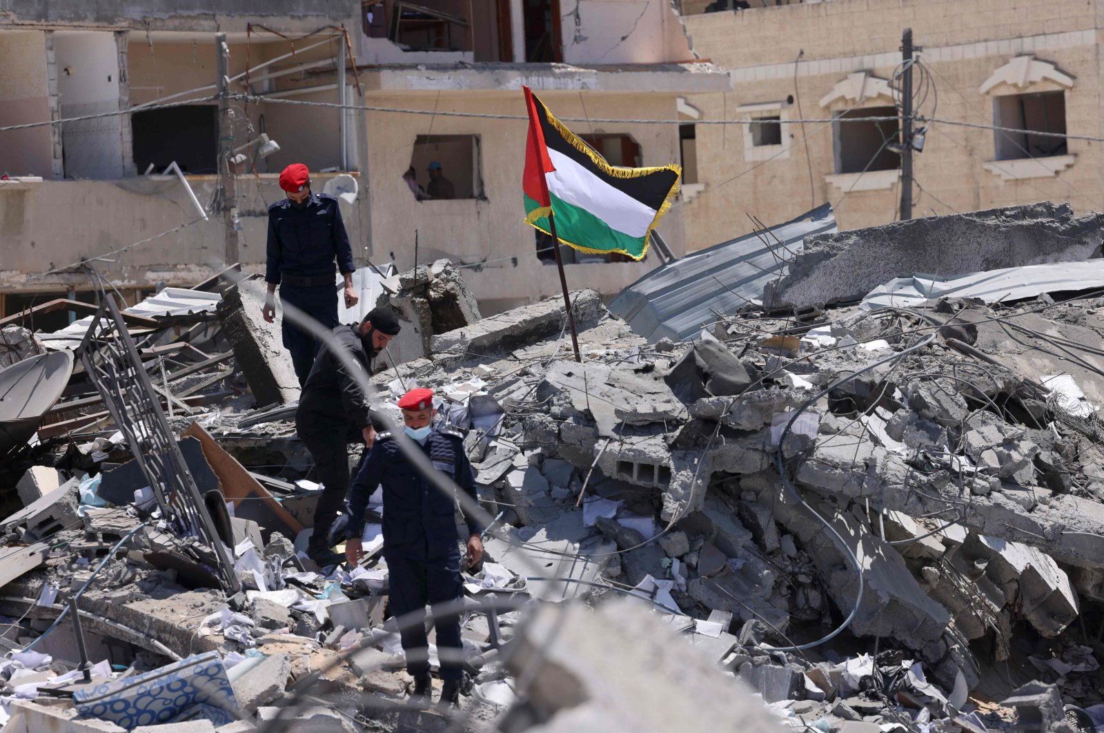 Palestinian police officers walk amid the rubble following a cease-fire in Gaza City, Gaza Strip, Palestine, on May 22, 2021. (AFP Photo)
