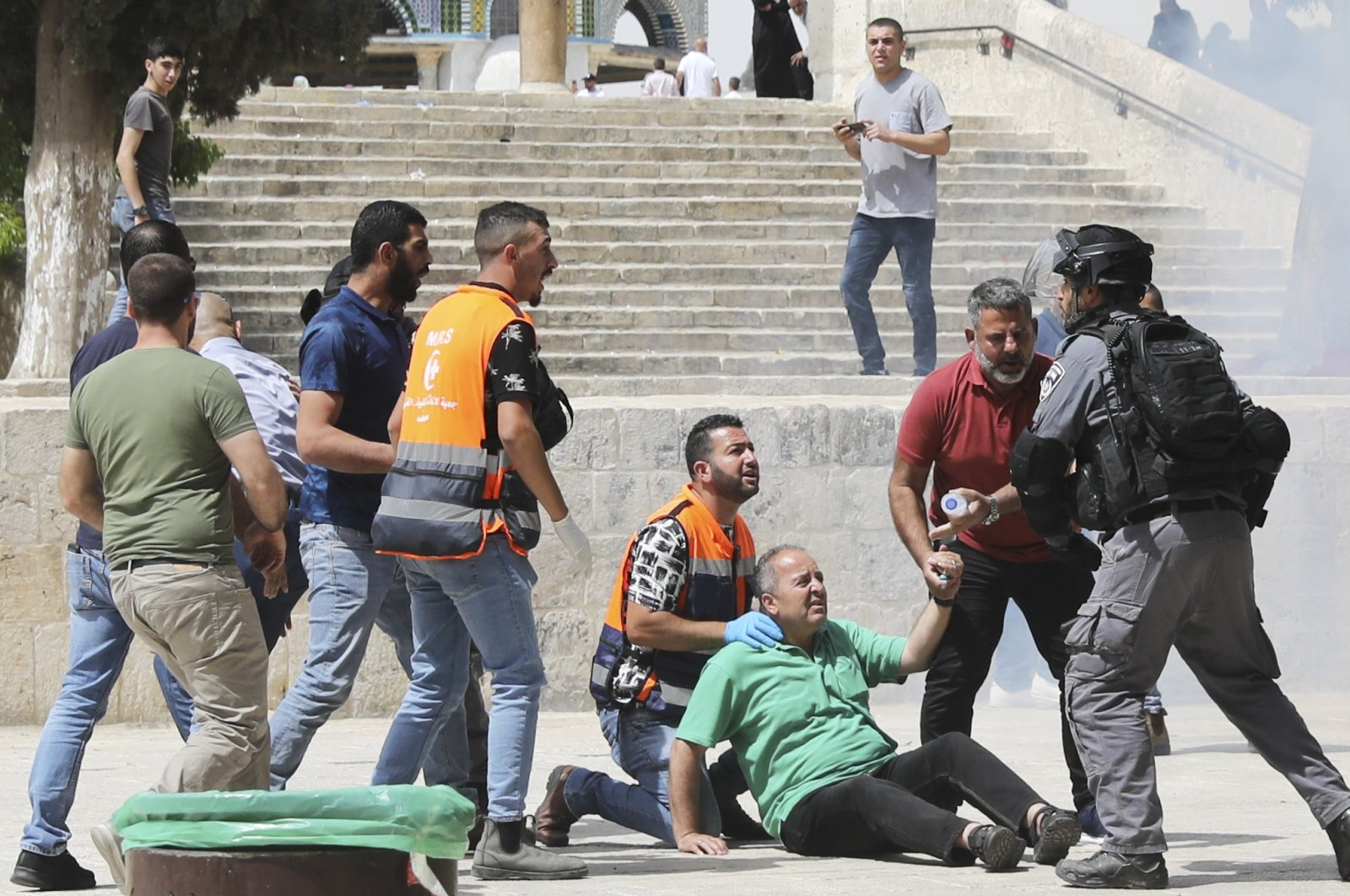 Israeli police clear Palestinians from the plaza in front of the Dome of the Rock at Al-Aqsa Mosque in East Jerusalem, Palestine, Friday, May 21, 2021. (AP Photo)