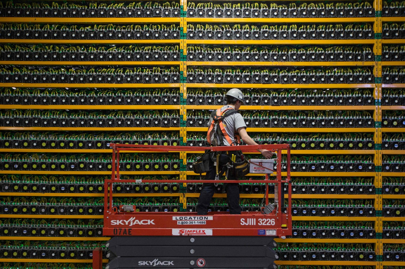 A technician inspects a bitcoin mine at Bitfarms in Saint Hyacinthe, Quebec, Canada, March 19, 2018. (AFP Photo)