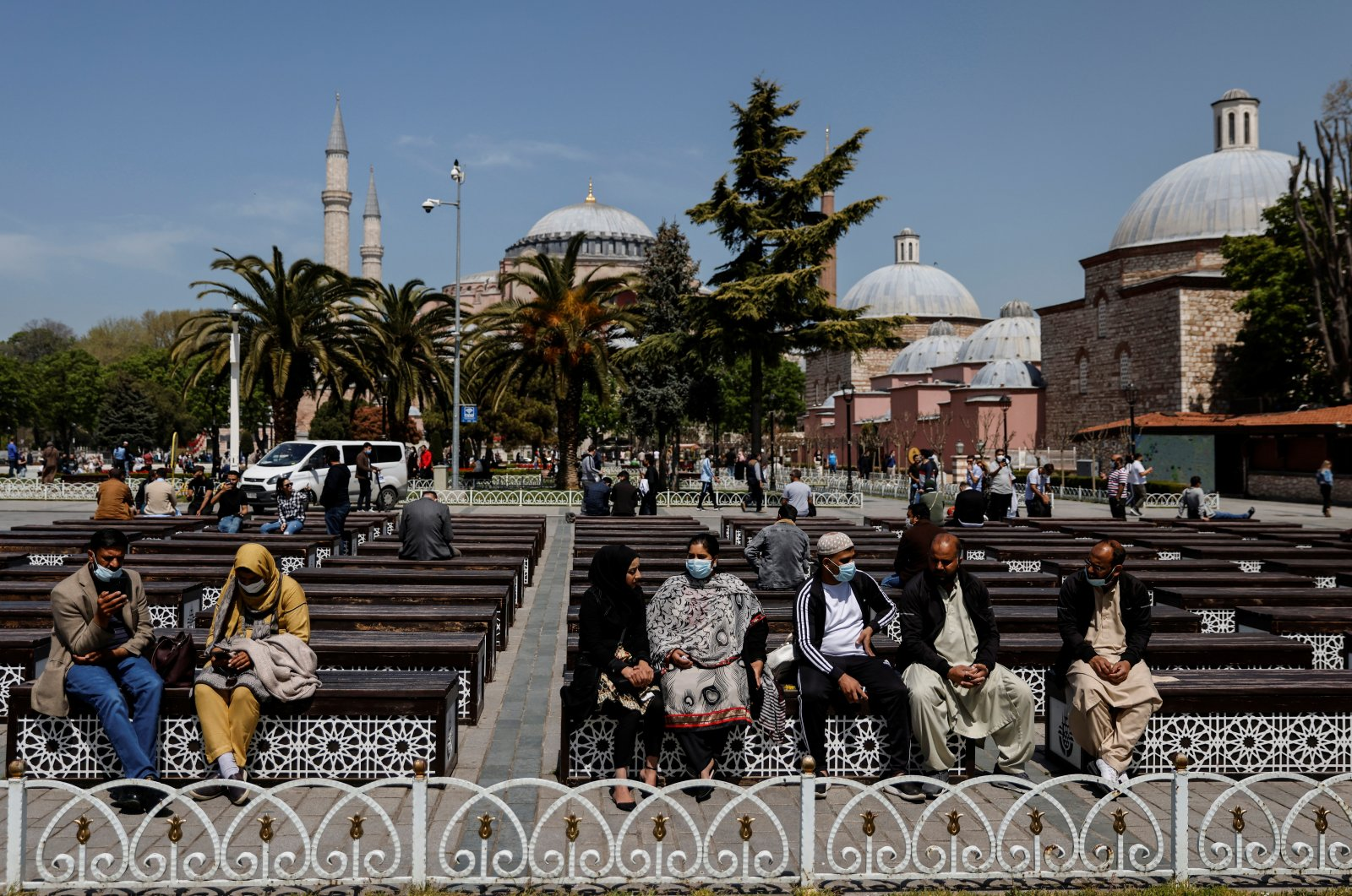 """Tourists enjoy a sunny day outside the Hagia Sophia Grand Mosque during a nationwide """"full closure"""" amid the spread of the coronavirus, in Istanbul, Turkey, April 30, 2021. (Reuters Photo)"""