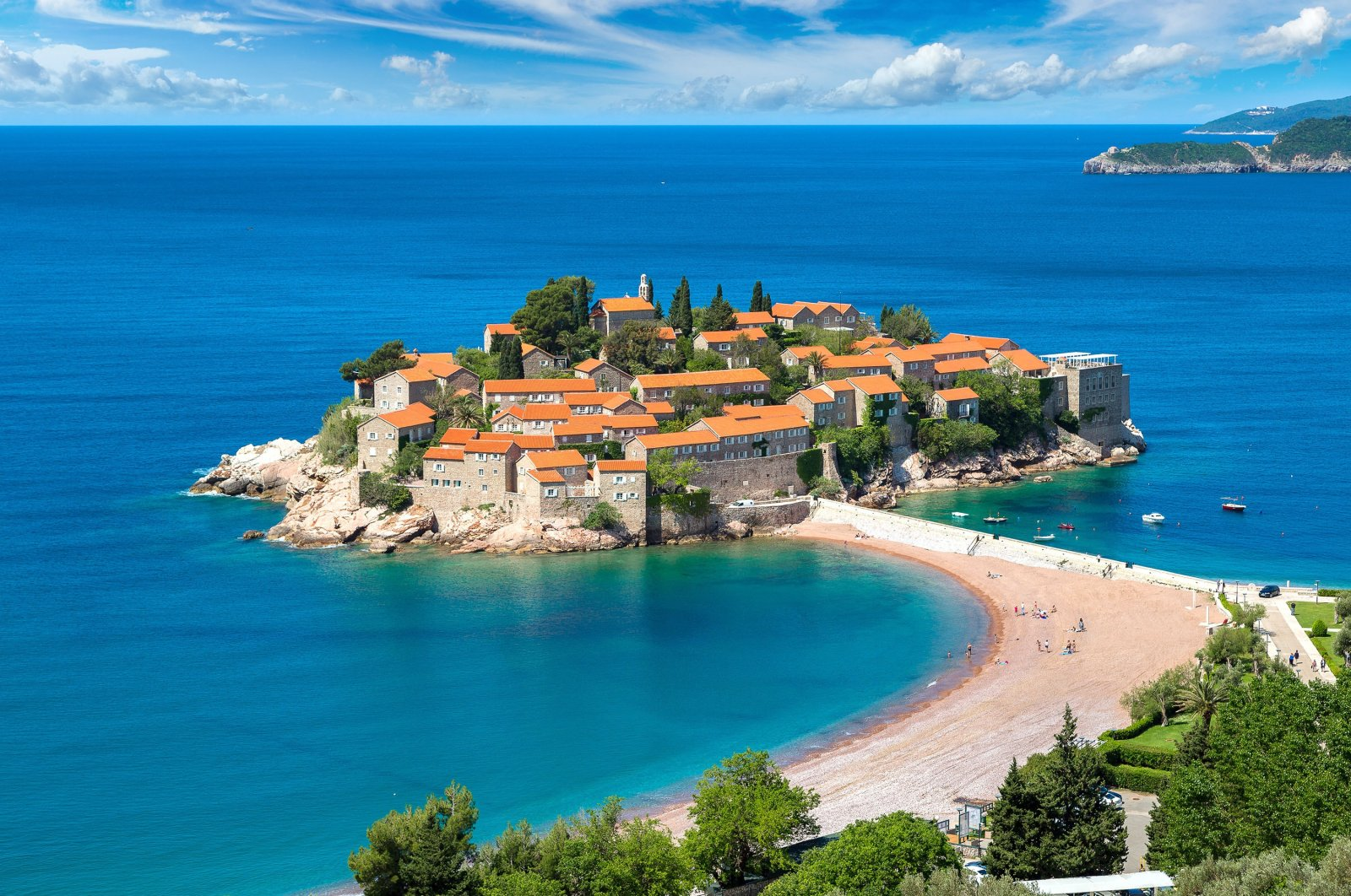 The small islet of Sveti Stefan stands surrounded by the waters of the Adriatic Sea in western Montenegro. (Shutterstock Photo)