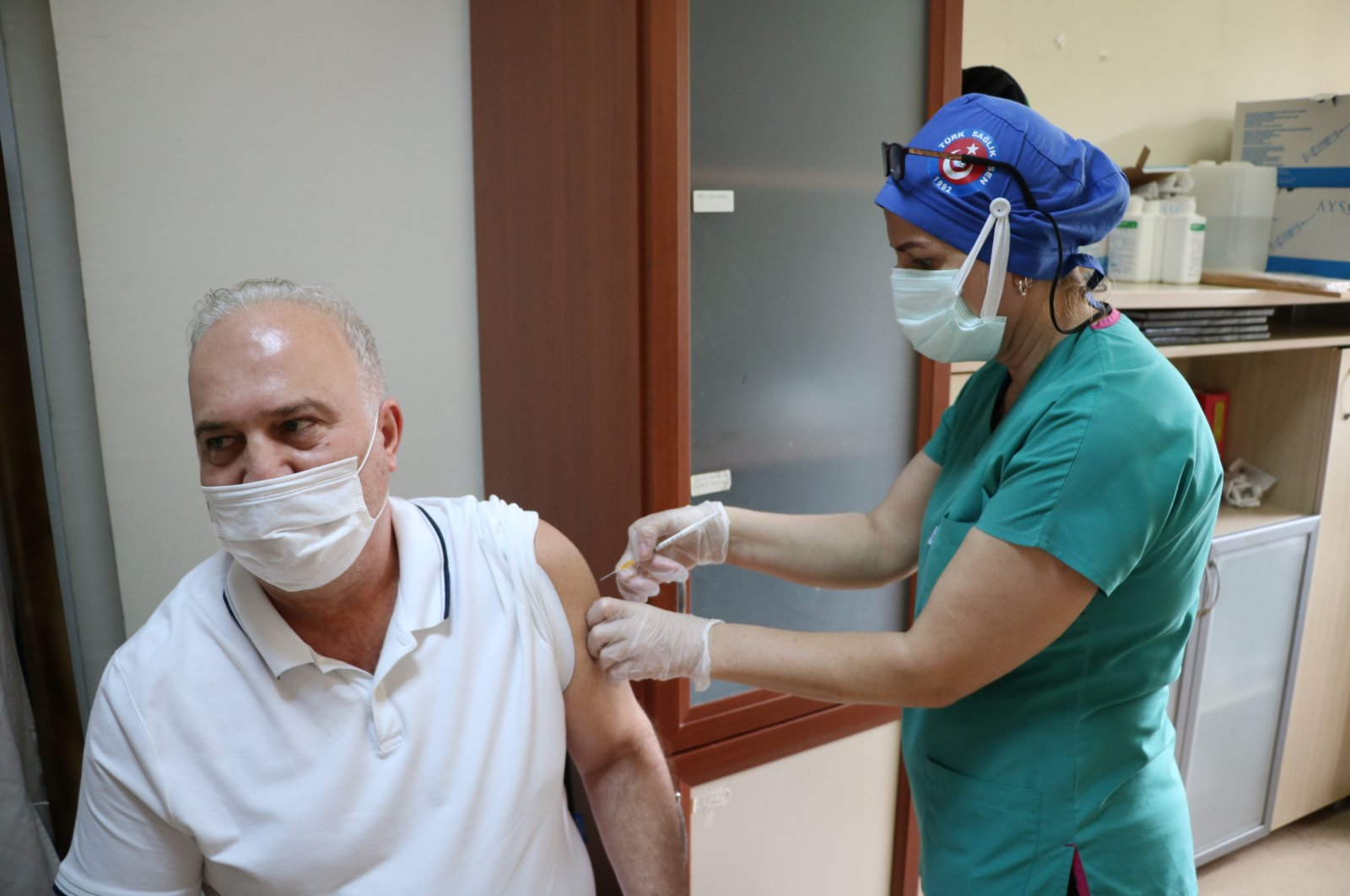 A man gets vaccinated at a hospital in Çanakkale, western Turkey, May 21, 2021. (AA PHOTO)