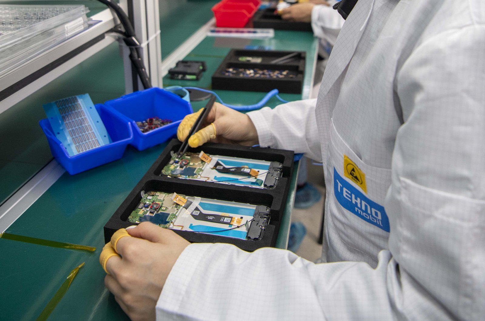 An employee works on a smartphone at Tecno Mobile factory in Istanbul, Turkey, May 24, 2021. (Courtesy of Tecno Mobile )