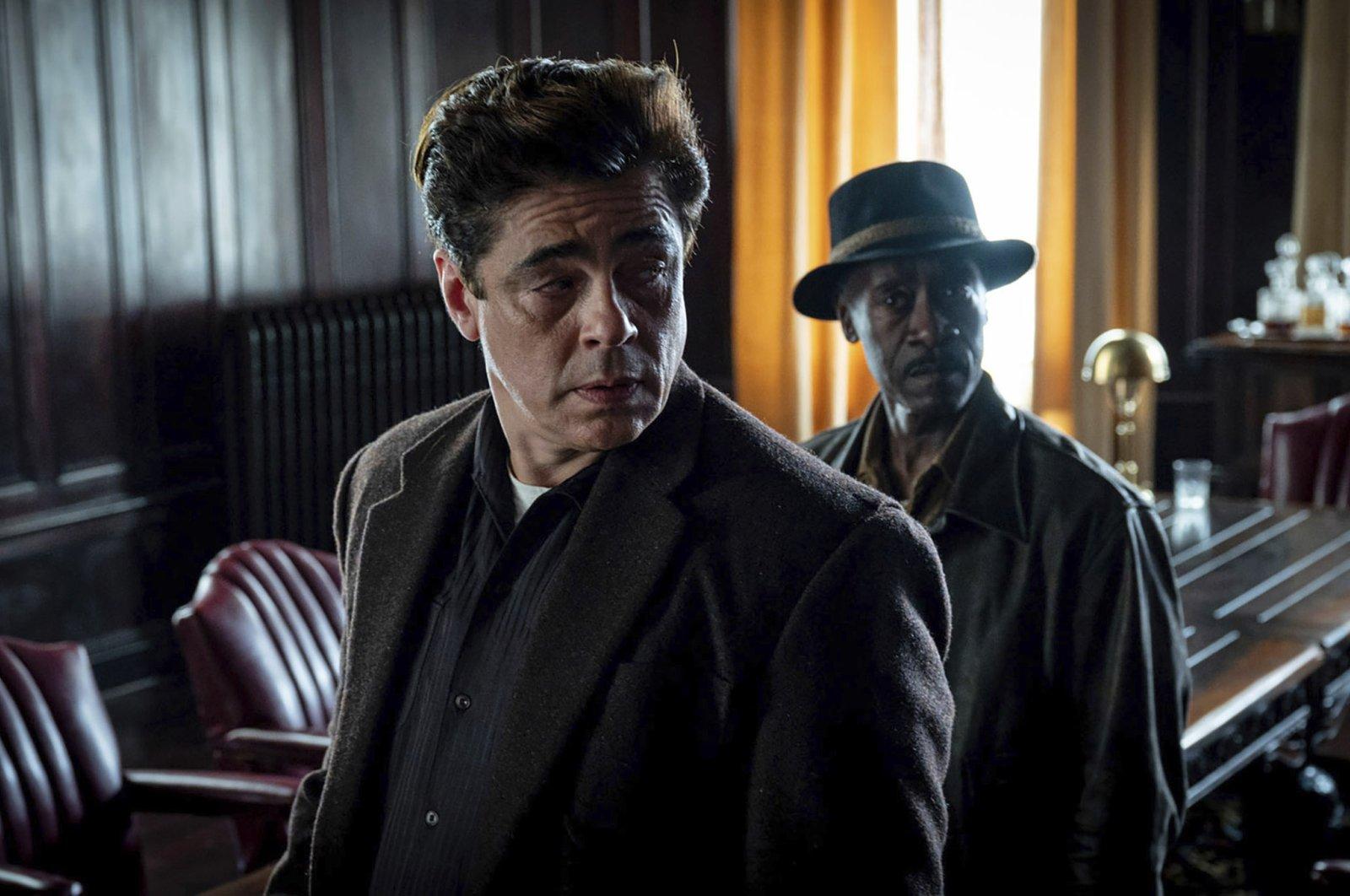 "Benicio del Toro (L), and Don Cheadle look off-camera in a scene from Steven Soderbergh's ""No Sudden Move,"" a film that will premiere as the centerpiece of the Tribeca Film Festival next month. (Warner Bros. Pictures via AP)"