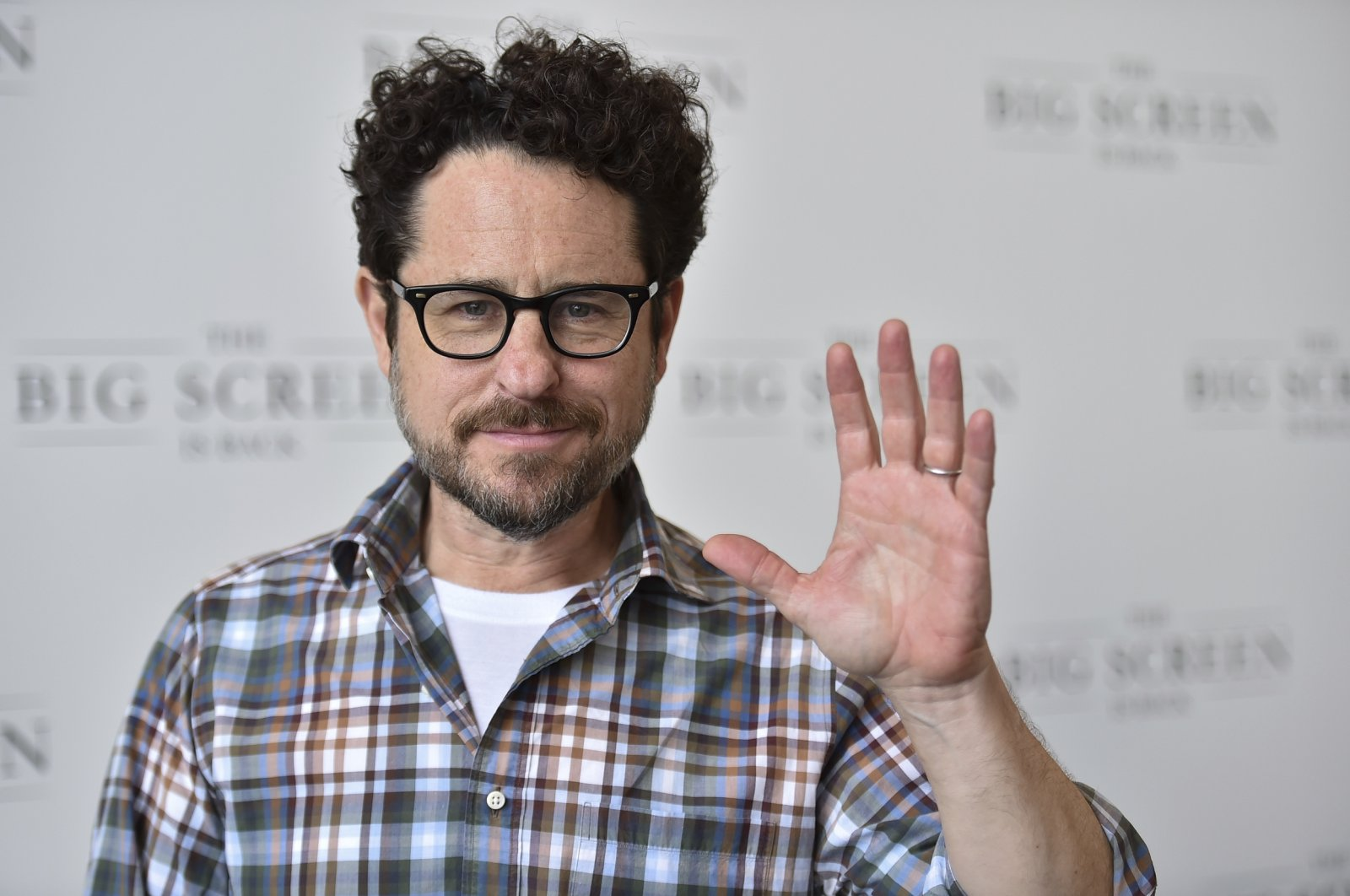 """Director J.J. Abrams arrives at """"The Big Screen is Back"""" media event that included 10 studios convening to showcase a sampling of their summer movie releases in Los Angeles, California, U.S., May 19, 2021. (AP Photo)"""
