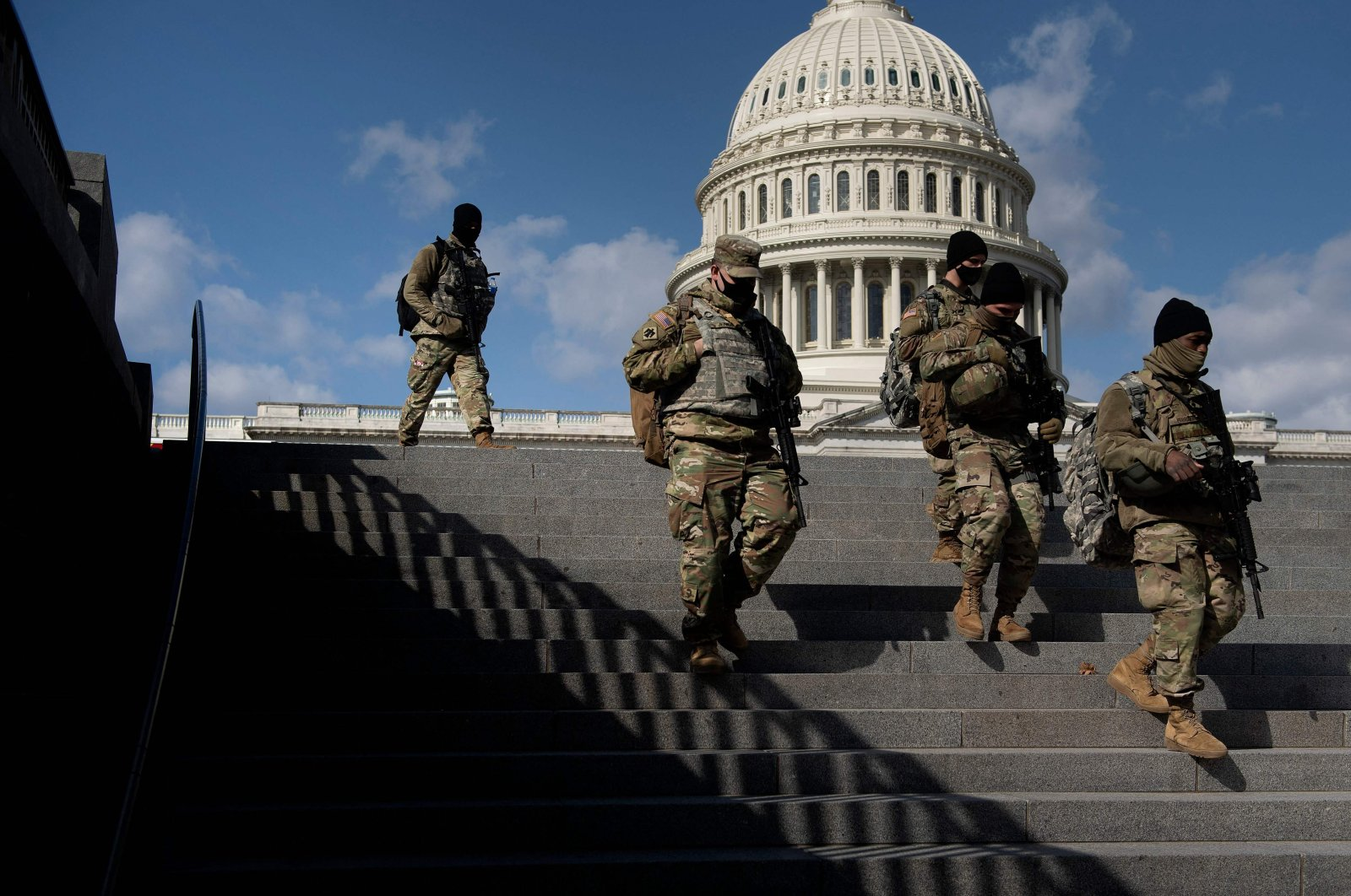 Members of the National Guard patrol the grounds of the U.S. Capitol in Washington, D.C., March 4, 2021. (AFP Photo)