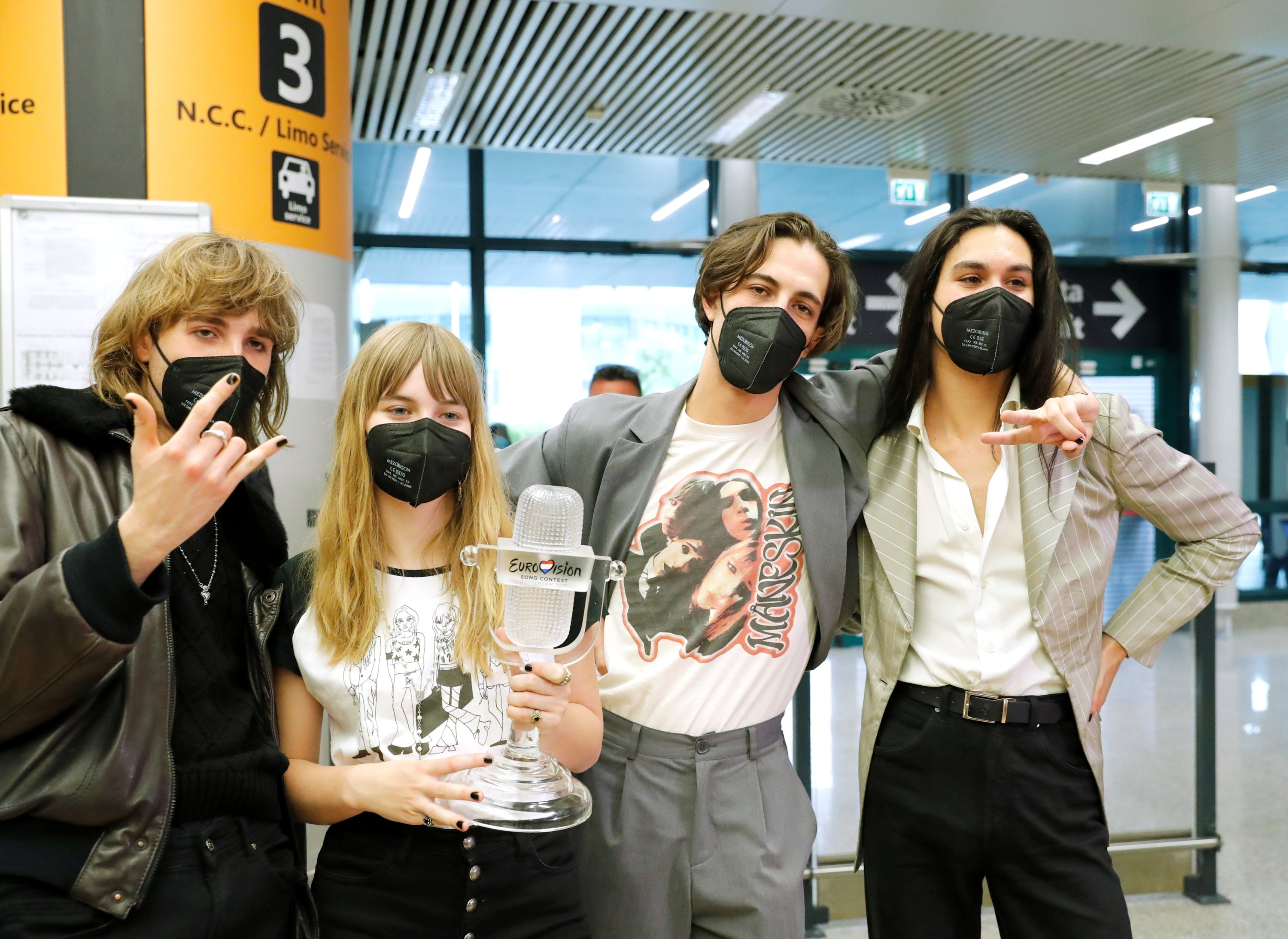 Members of Italian rock band Maneskin pose for a picture as they return to Italy following their 2021 Eurovision Song Contest victory, in Rome, Italy, May 23, 2021. (REUTERS Photo)