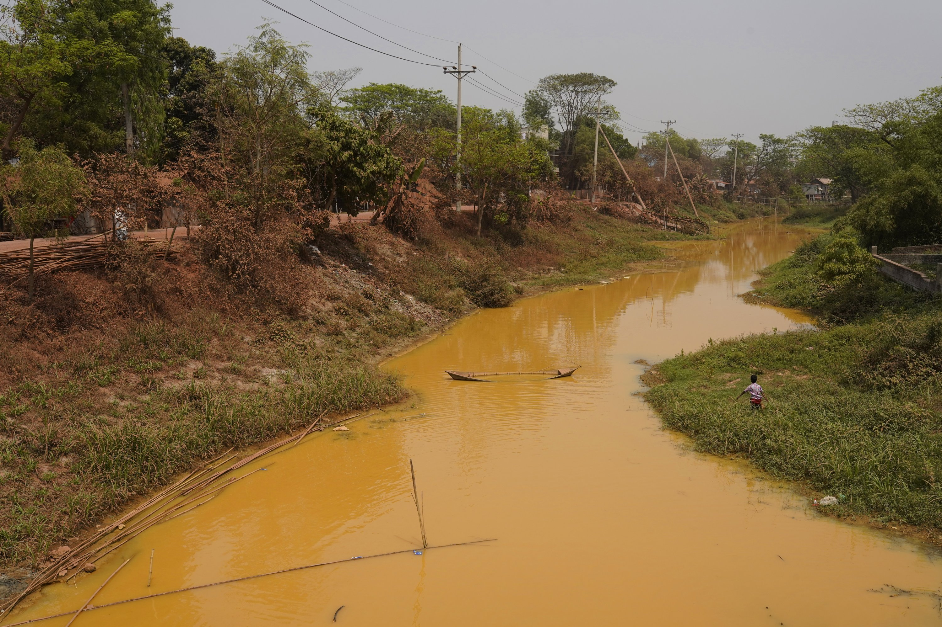 An overall view of a canal polluted by wastewater from a water treatment plant at Savar in Dhaka, Bangladesh, March 21, 2021. (Photo by Getty Images)
