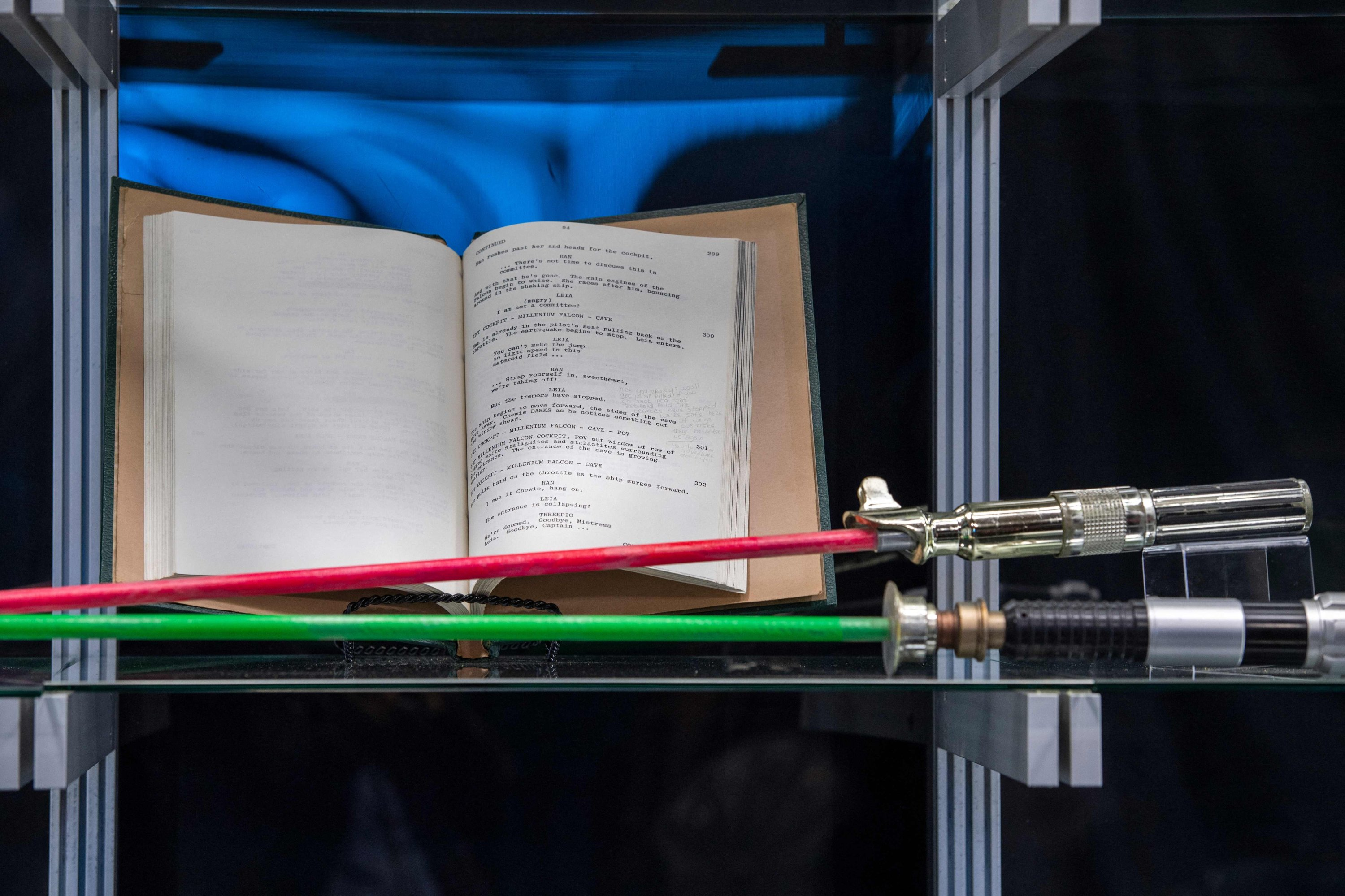 Obi-Wan Kenobi and Anakin Skywalker's bladed dueling lightsabers and Carrie Fisher's heavily hand-annotated script from 'The Empire Strikes Back,' are among the items exhibited during a press preview of Prop Store's Iconic Film & TV Memorabilia in Valencia, California, May 14, 2021. (AFP Photo)