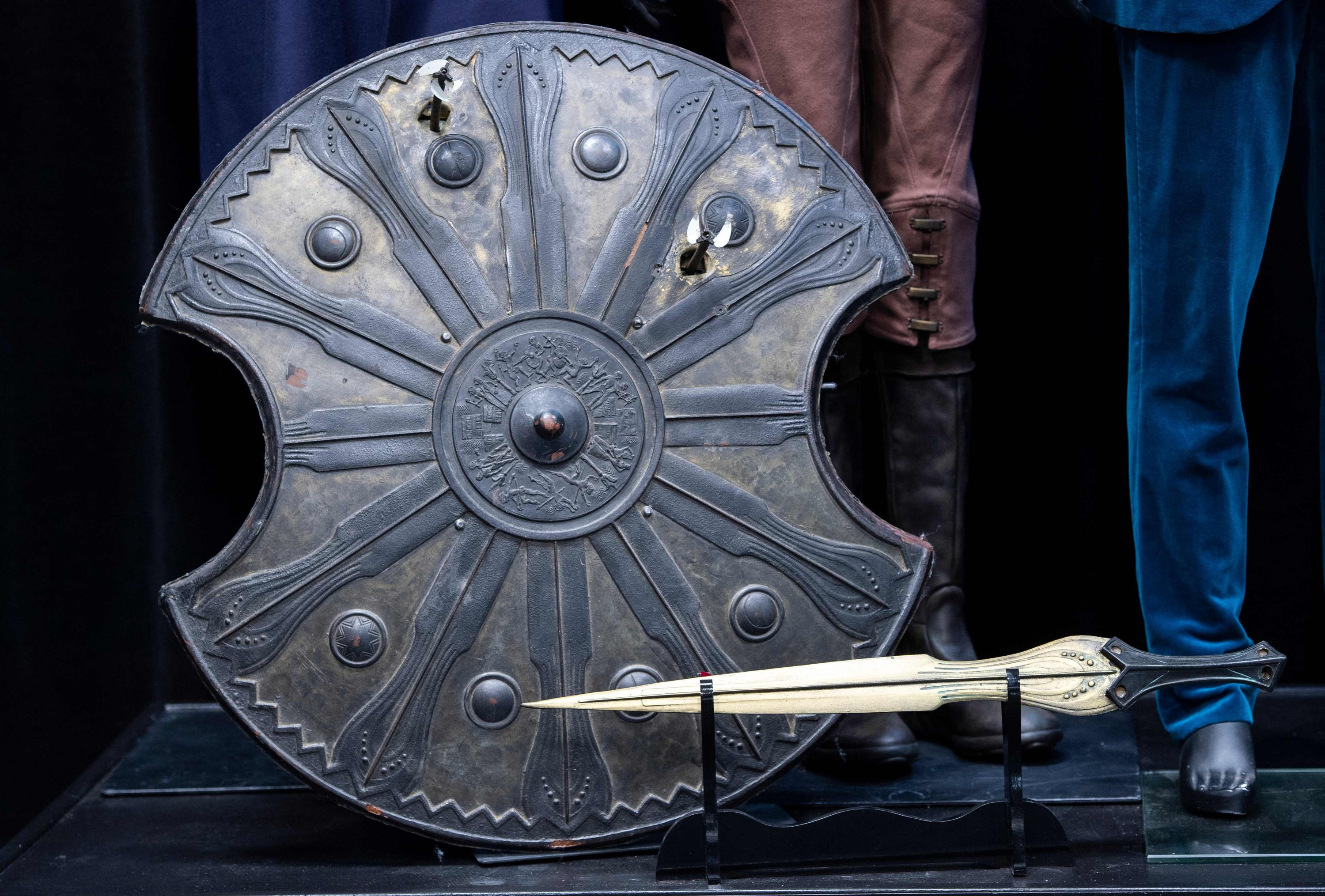 Brad Pitt's shield and sword from the movie 'Troy' are exhibited during a press preview of Prop Store's Iconic Film & TV Memorabilia in Valencia, California, May 14, 2021. (AFP Photo)