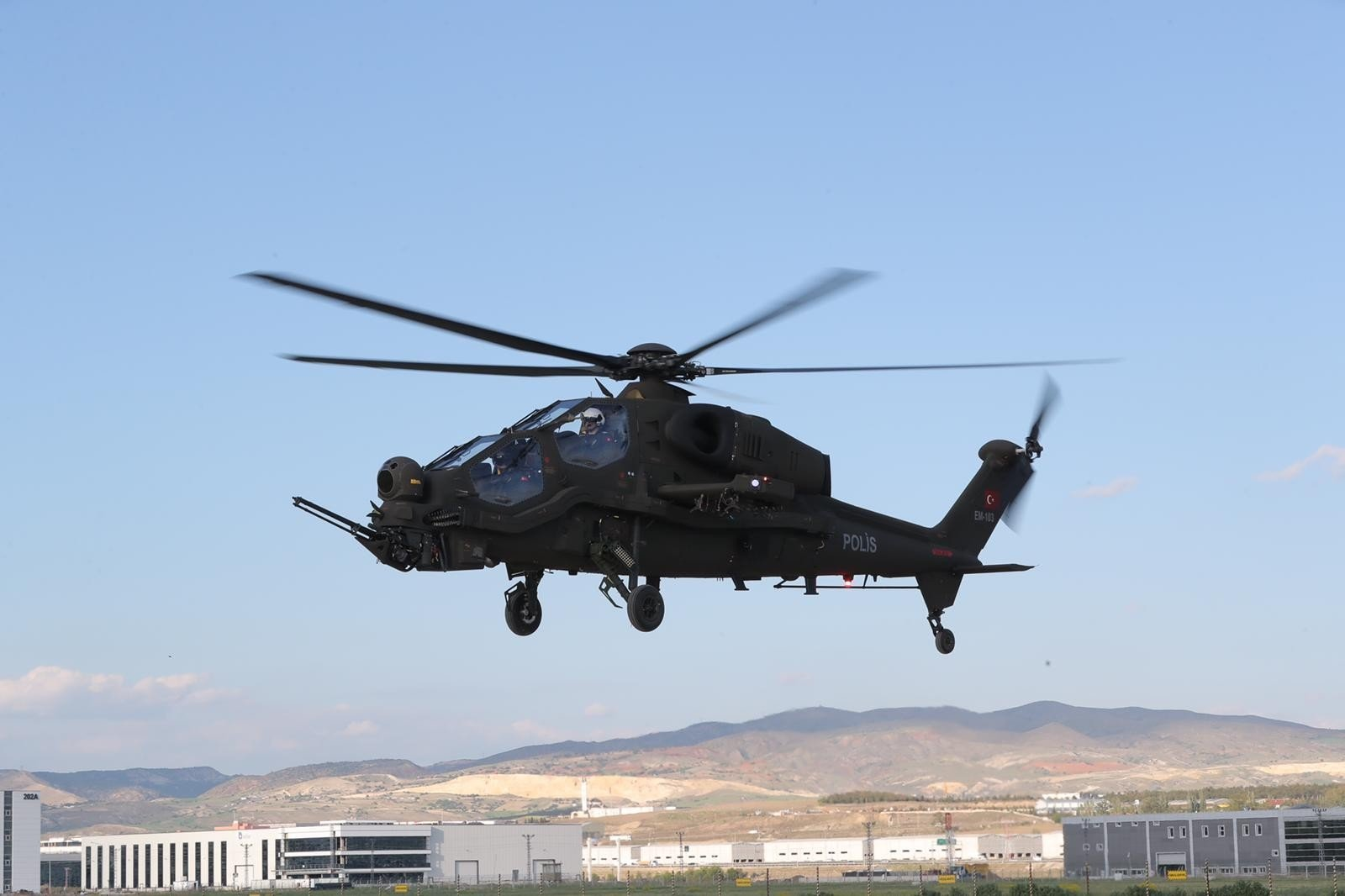 The upgraded version of the T129 Tactical Reconnaissance and Attack Helicopter delivered to Turkey's General Directorate of Security flies over the capital, Ankara, Turkey, May 17, 2021. (IHA Photo)
