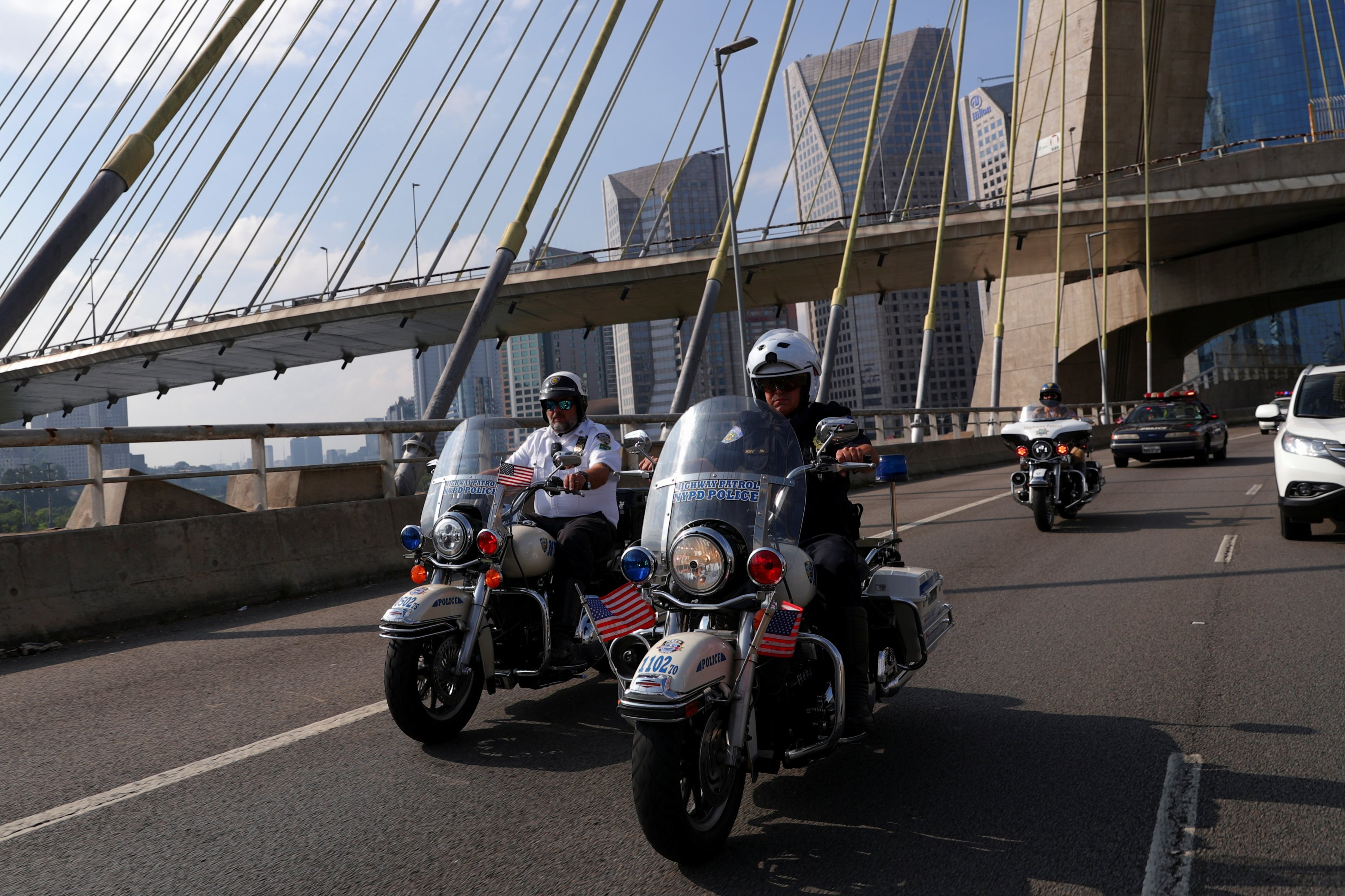 Brazilian fans of the New York Police Department (NYPD), whose hobby is to recreate the NYPD's cars and motorbikes, ride in Sao Paulo, Brazil, May 16, 2021. (Reuters Photo)