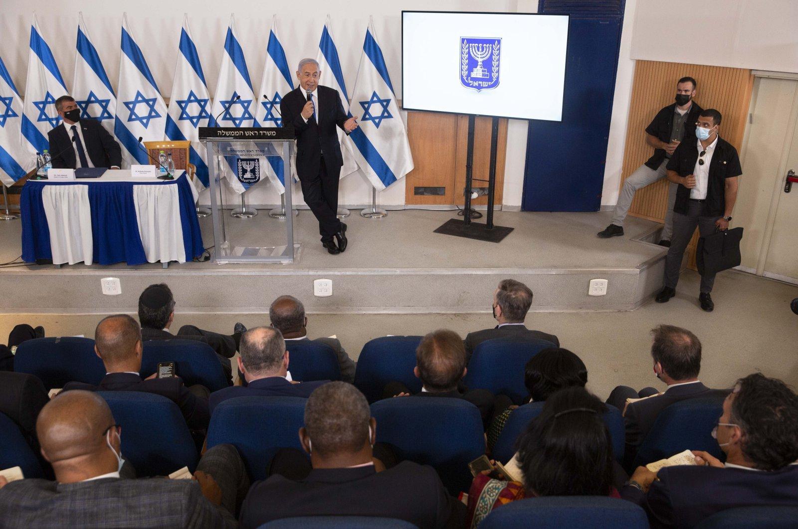 Israeli Prime Minister Benjamin Netanyahu speaks during a briefing to ambassadors to Israel at the Hakirya military base in Tel Aviv, Israel, May 19, 2021. (AP File Photo)