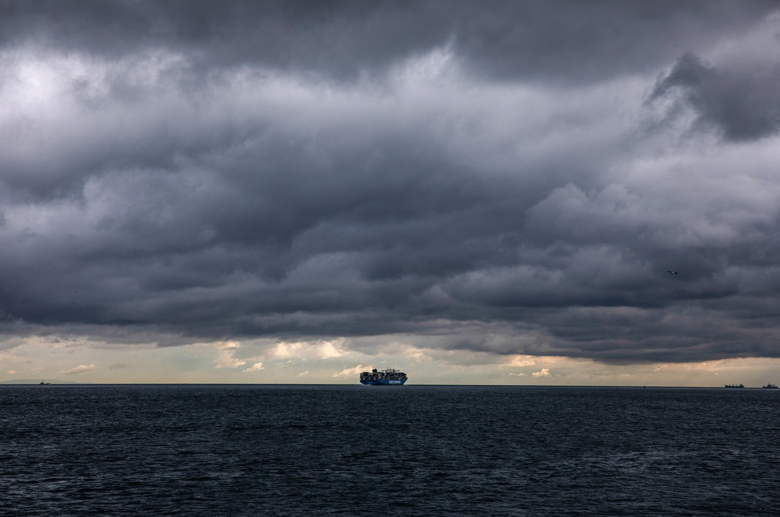 A cargo ship sails in the Marmara Sea on a cloudy day, Istanbul, Turkey, May 21, 2021. (Photo by Getty Images)