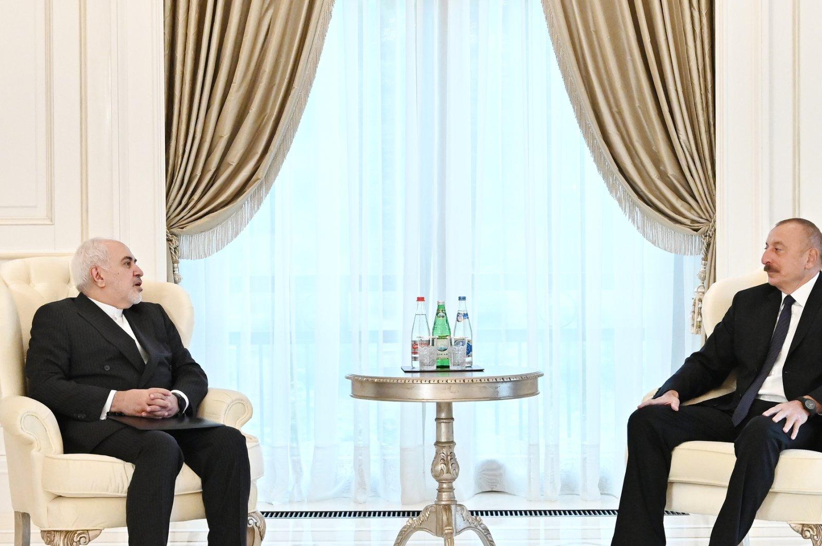 Azerbaijani President Ilham Aliyev (R) receives Iranian Foreign Minister Javad Zarif (L) in Baku, Azerbaijan, May 25, 2021. (AA Photo)
