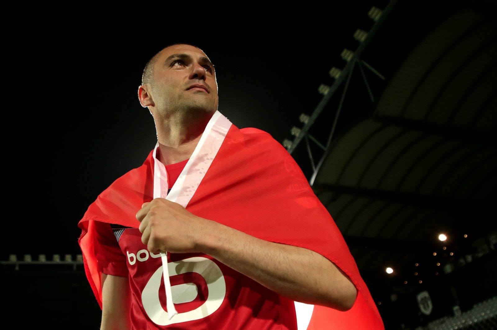 Lille's veteran Turkish forward Burak Yılmaz celebrates winning the French Ligue 1 title, Angers, France, May 23, 2021. (EPA Photo)