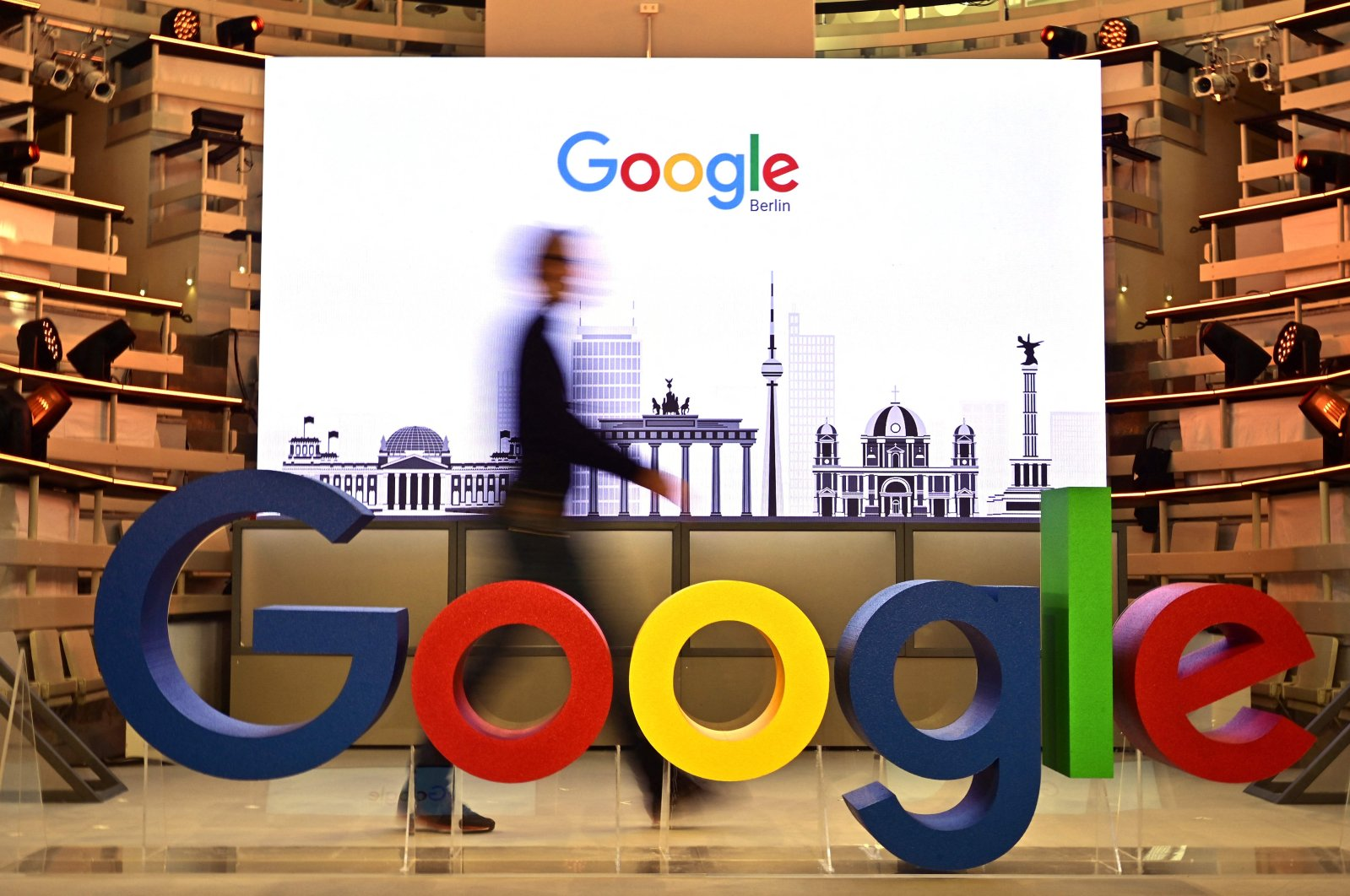 A technician passes by the logo of U.S. internet search giant Google during the opening day of a new office in Berlin, Germany, Jan. 22, 2019. (AFP Photo)