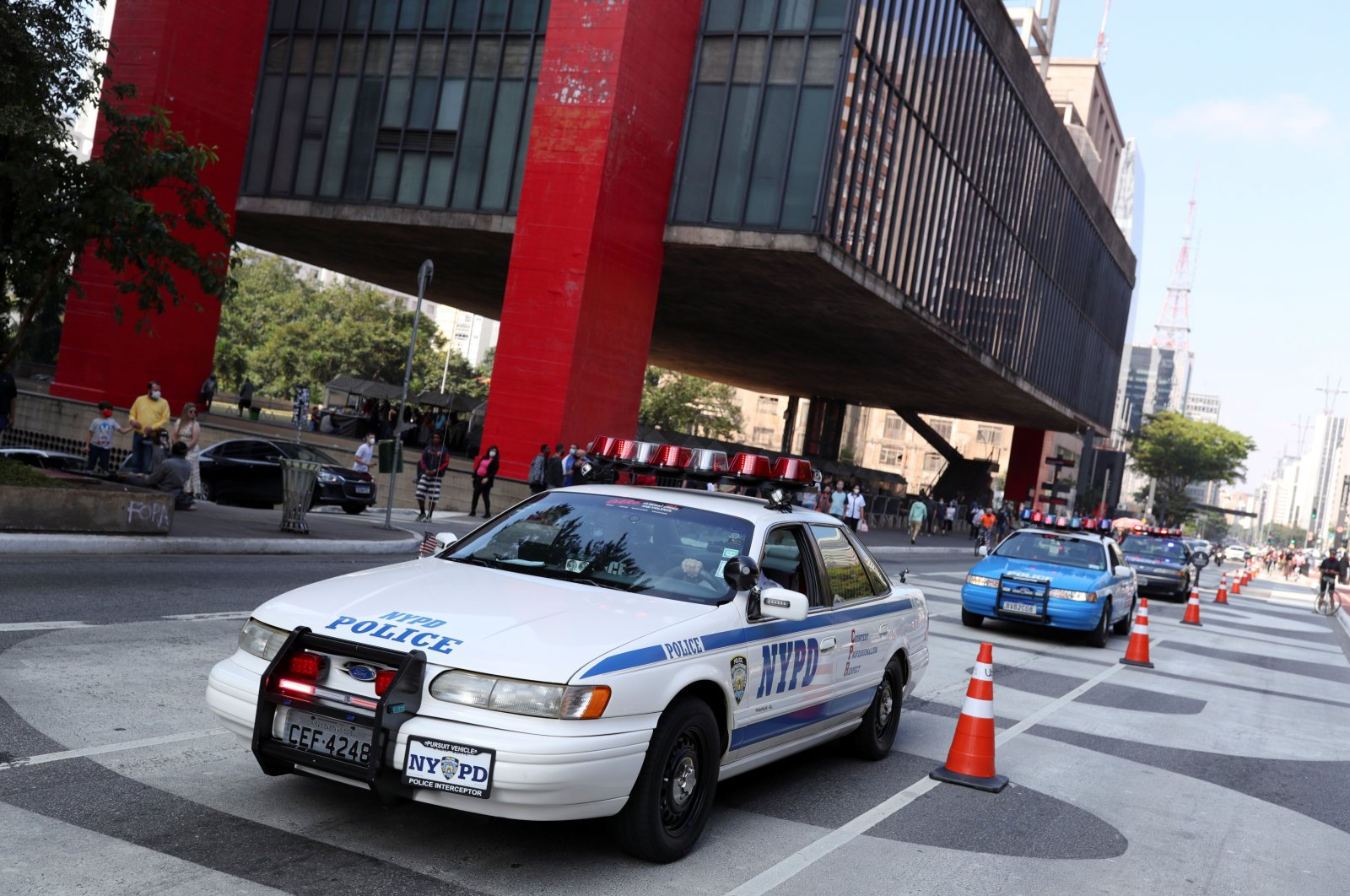 Brazilian fans of the New York Police Department (NYPD), whose hobby is to recreate the NYPD's cars and motorbikes, drive past Sao Paulo Museum of Art (MASP) in Sao Paulo, Brazil, May 16, 2021. (Reuters Photo)