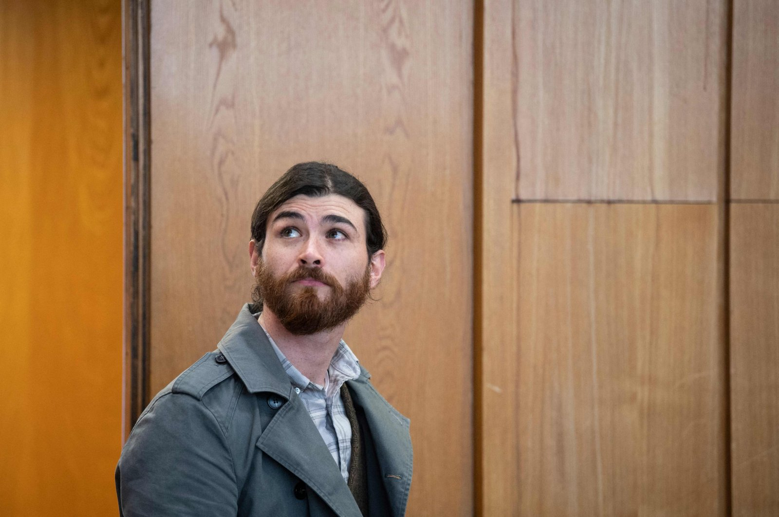 Franco Albrecht, a German soldier who allegedly plotted to attack prominent politicians while posing as a Syrian refugee, arrives at the Higher Regional Court for the start of his trial in Frankfurt am Main, western Germany, May 20, 2021. (AFP Photo)