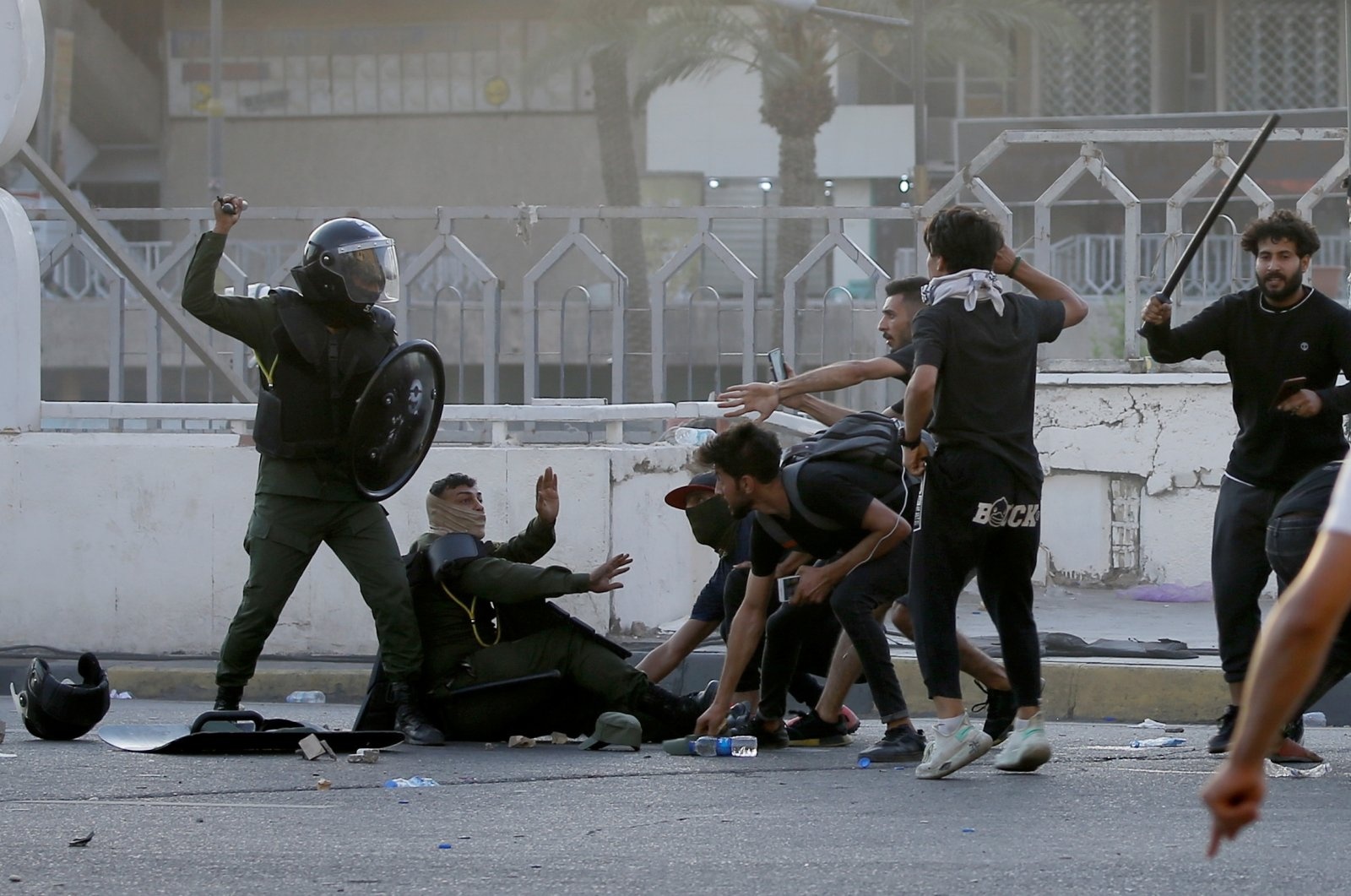 Members of security forces clash with demonstrators during an anti-government protest in Baghdad, Iraq, May 25, 2021. (Reuters Photo)