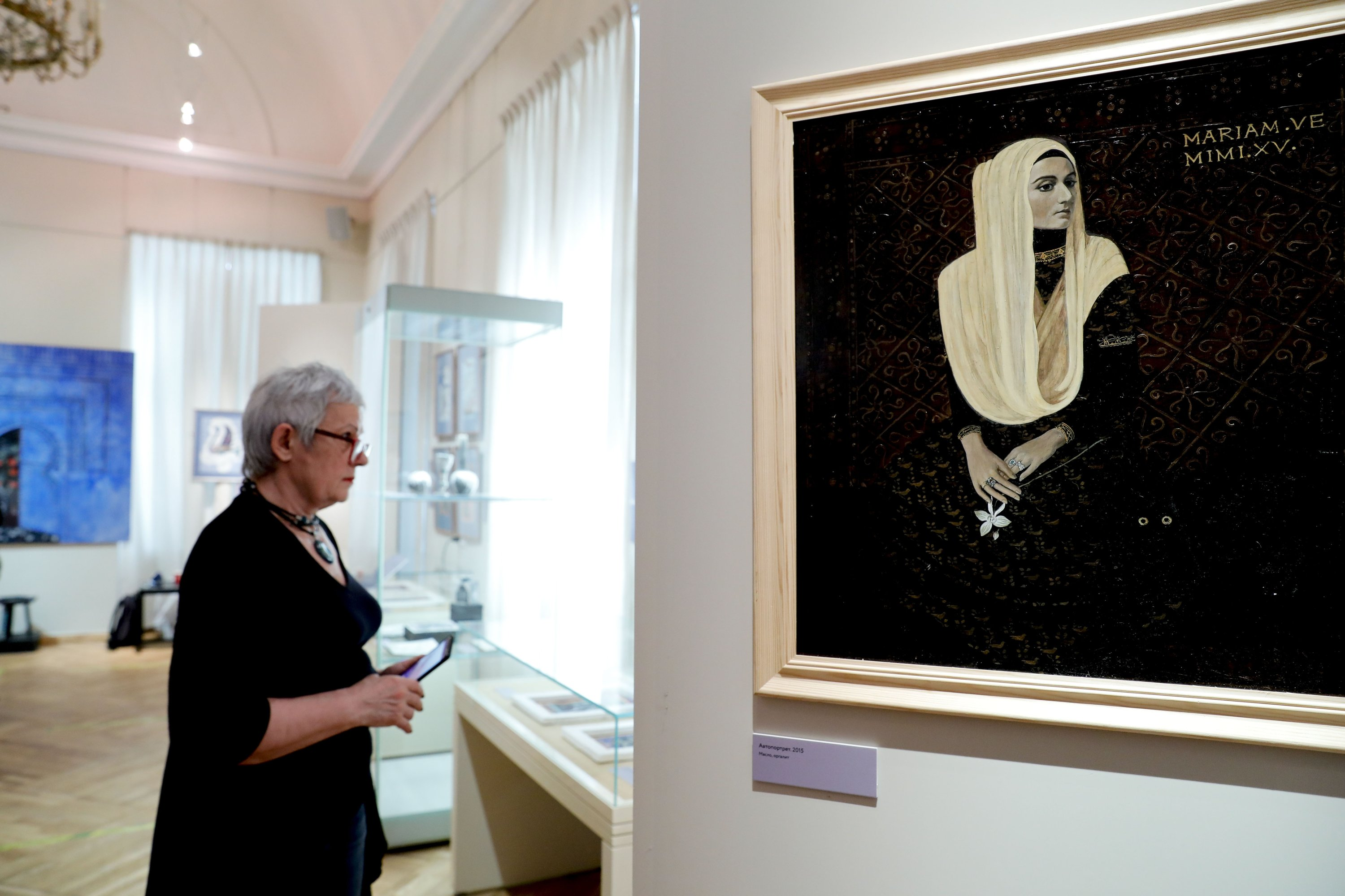 A visitor examines works by Mariya Komisa at the State Museum of Oriental Art in Moscow, Russia, May 25, 2021. (AA Photo)