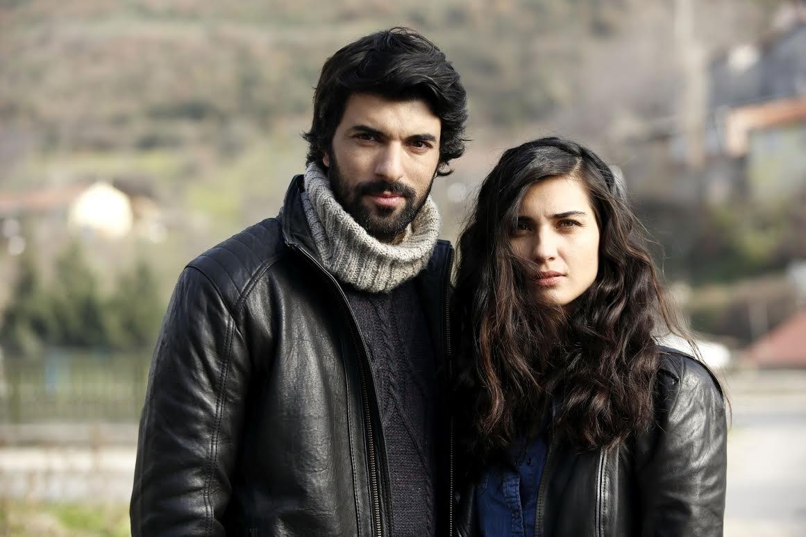 "A still shot shows Engin Akyürek (L) and Tuba Büyüküstün in ""Kara Para Aşk"" (""Black Money Love"")."