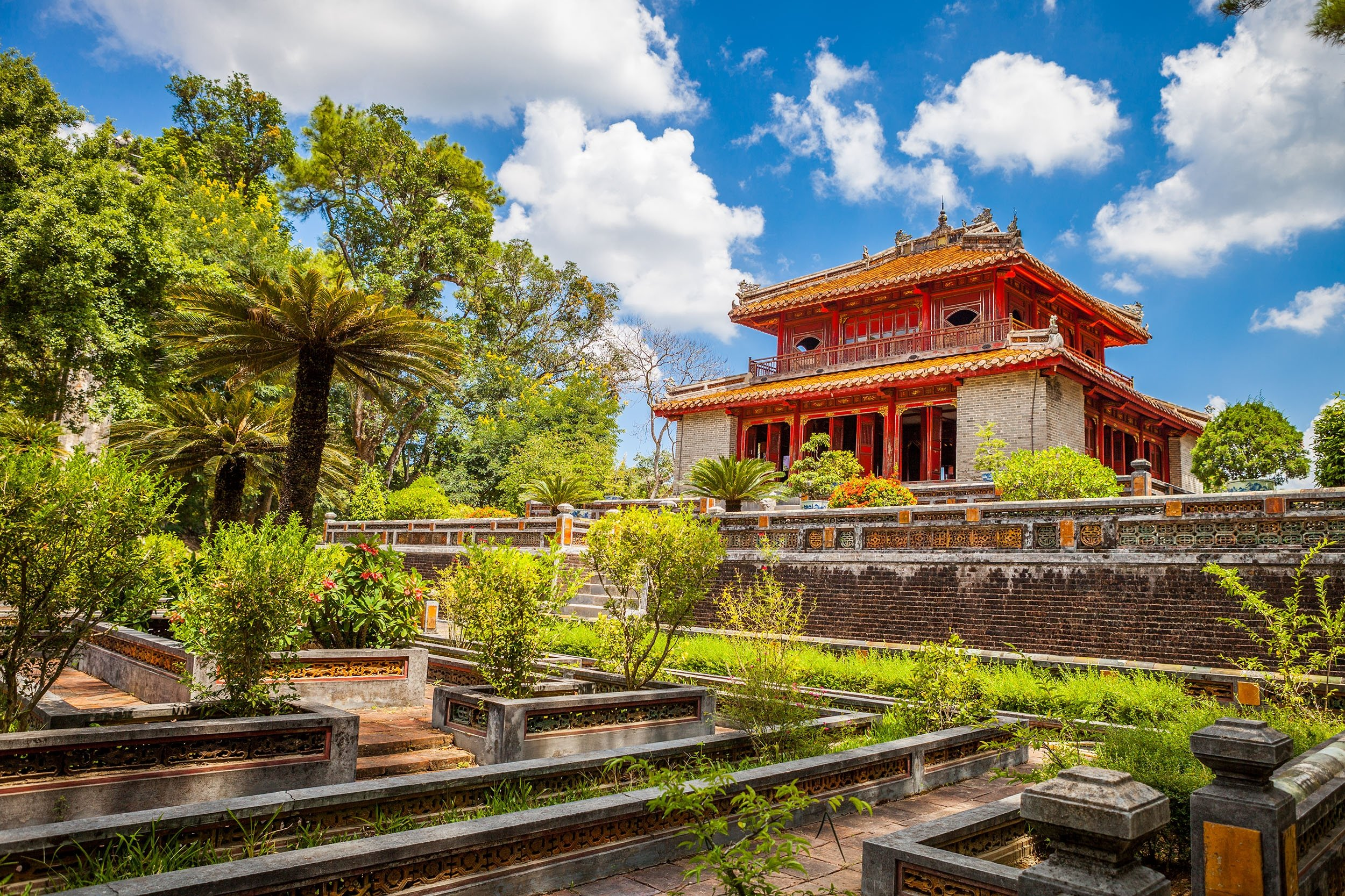 Green trees and the historical pavilion of Minh Lau at the Minh Mang Emperor Tomb can be seen in Hue, Vietnam. (Shutterstock Photo)