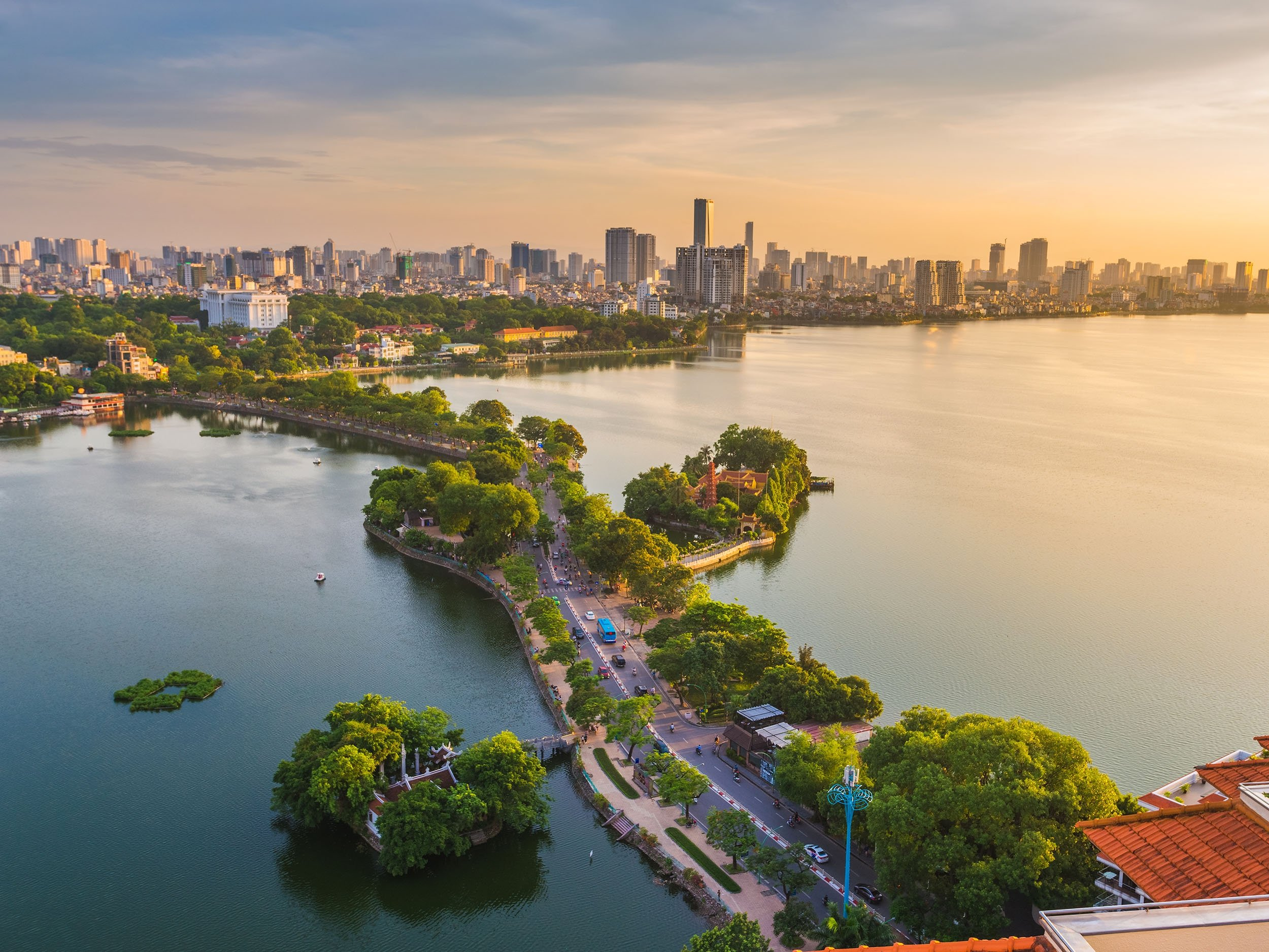 The skyline on the city of Hanoi is draped with orange hues in the sunset, Vietnam. (Shutterstock Photo)