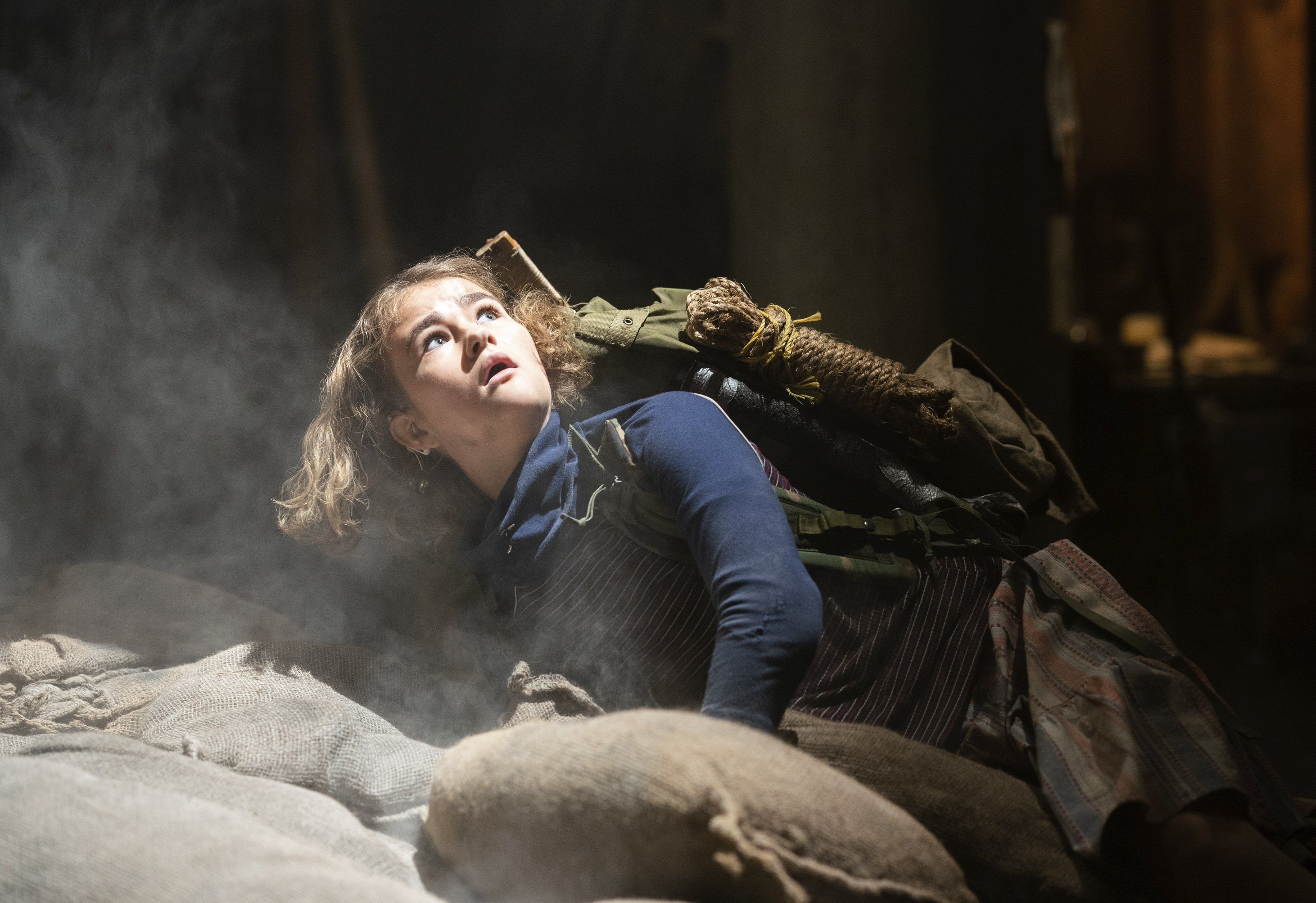 Millicent Simmonds looks up into the sunlight in the sky, ina scene from'A Quiet Place Part II.' (Paramount Pictures via AP)