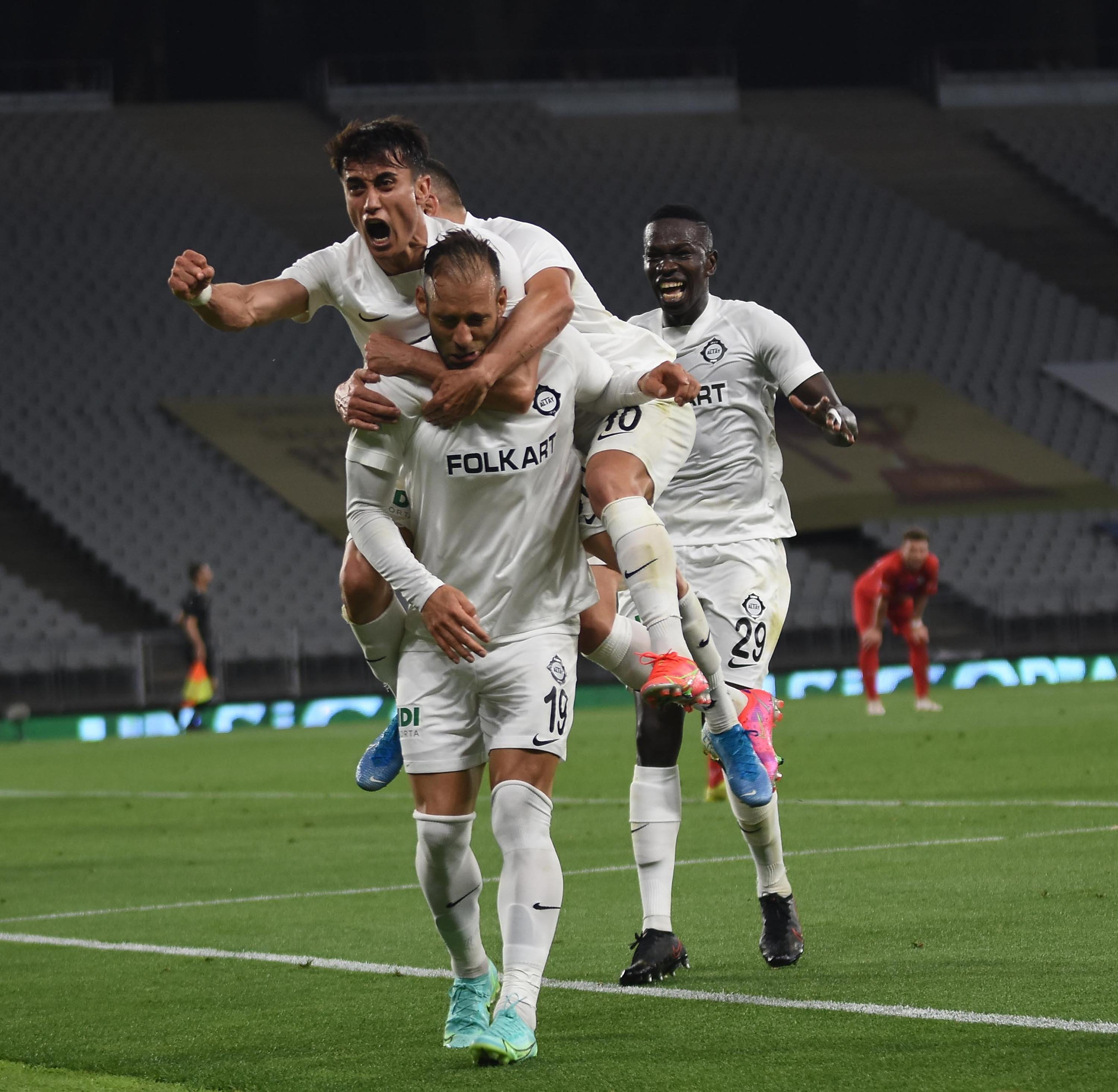 Altay players celebrate as Portuguese forward Marco Paixao scores the winner against Altınordu in the final match of the TFF 1. Lig playoffs at the Atatürk Olympic Stadium, Istanbul, Turkey,  May 26, 2021. (DHA Photo)