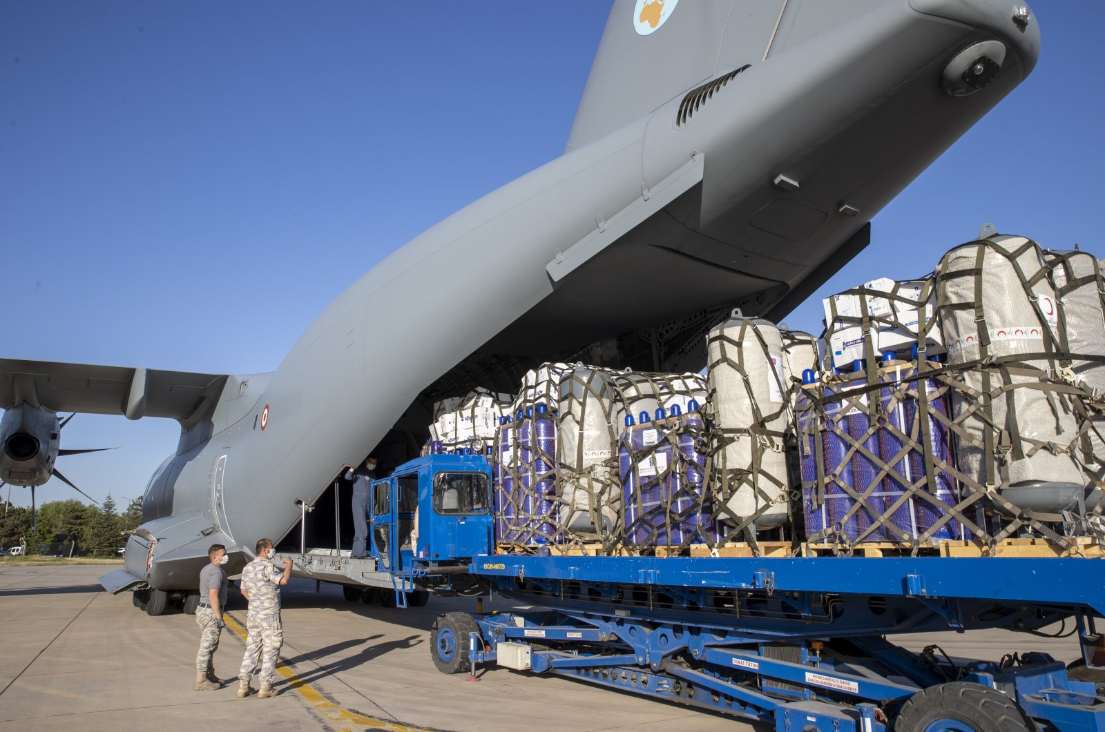 Medical aid bound for India to help fight the COVID-19 pandemic is loaded into a Turkish military aircraft at Etimesgut Air Base in Ankara, Turkish, May 25, 2021. (AA Photo)