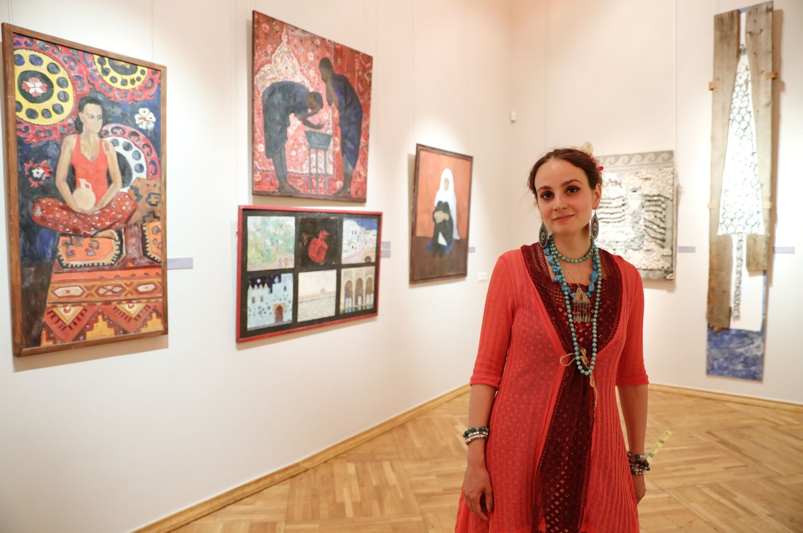 """Mariya Komisa poses in front of her works from """"Letter of the Traveler"""" at the State Museum of Oriental Art in Moscow, Russia, May 25, 2021. (AA Photo)"""
