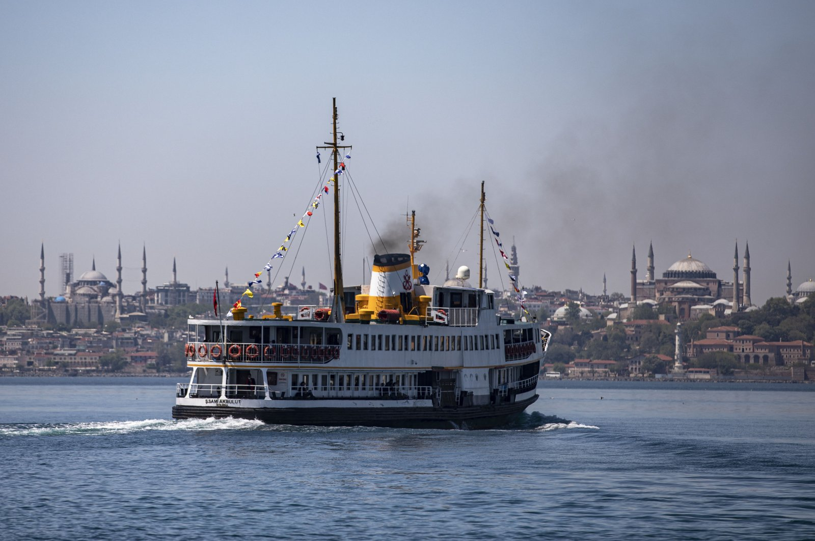 An iconic ferry cruises along with the historical Blue Mosque (L) and Hagia Sophia Grand Mosque (R) visible in the background, Istanbul, Turkey, May 13, 2021. (Photo by Getty Images)