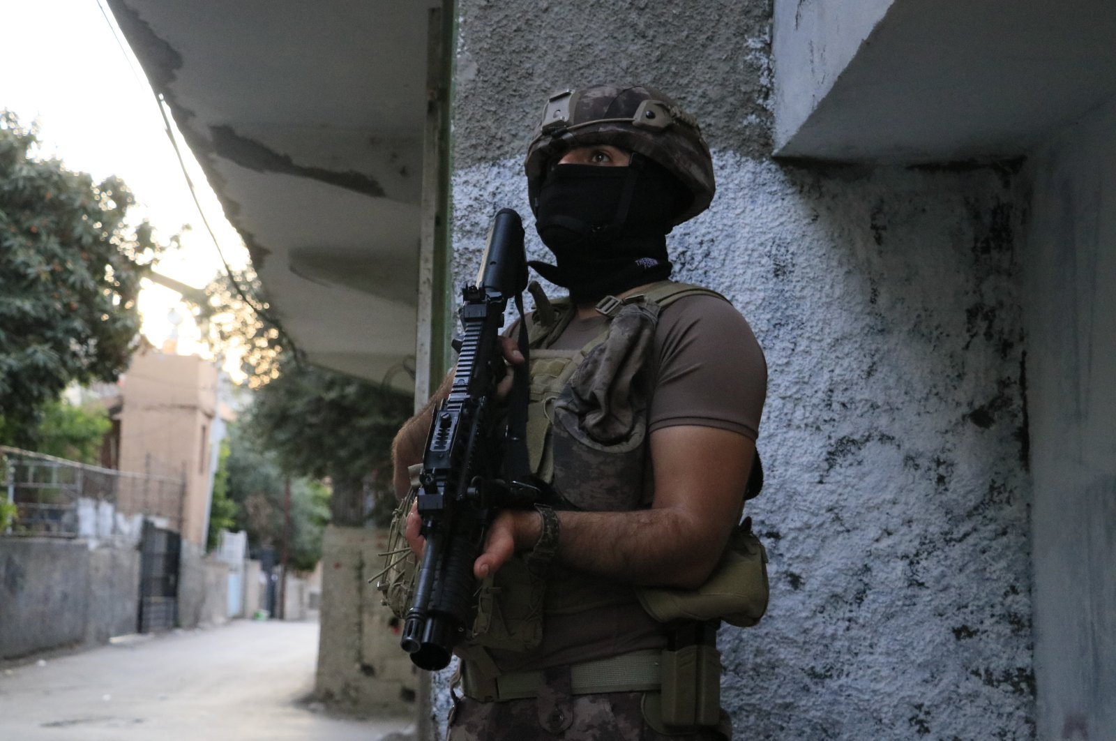 A special operations police stands in front of a building during raids in Turkey's southern Adana province, May 24, 2021. (IHA File Photo)