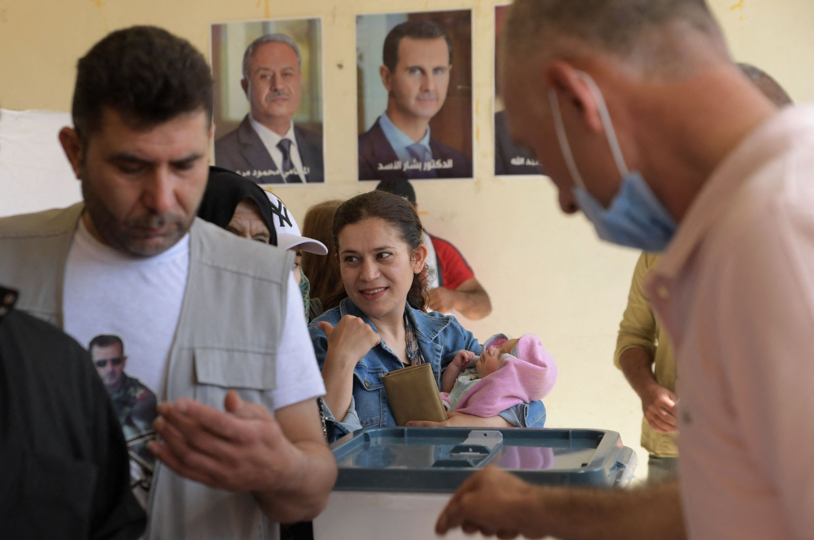 Syrians vote at a polling station in Aleppo, Syria, May 26, 2021. (AFP Photo)