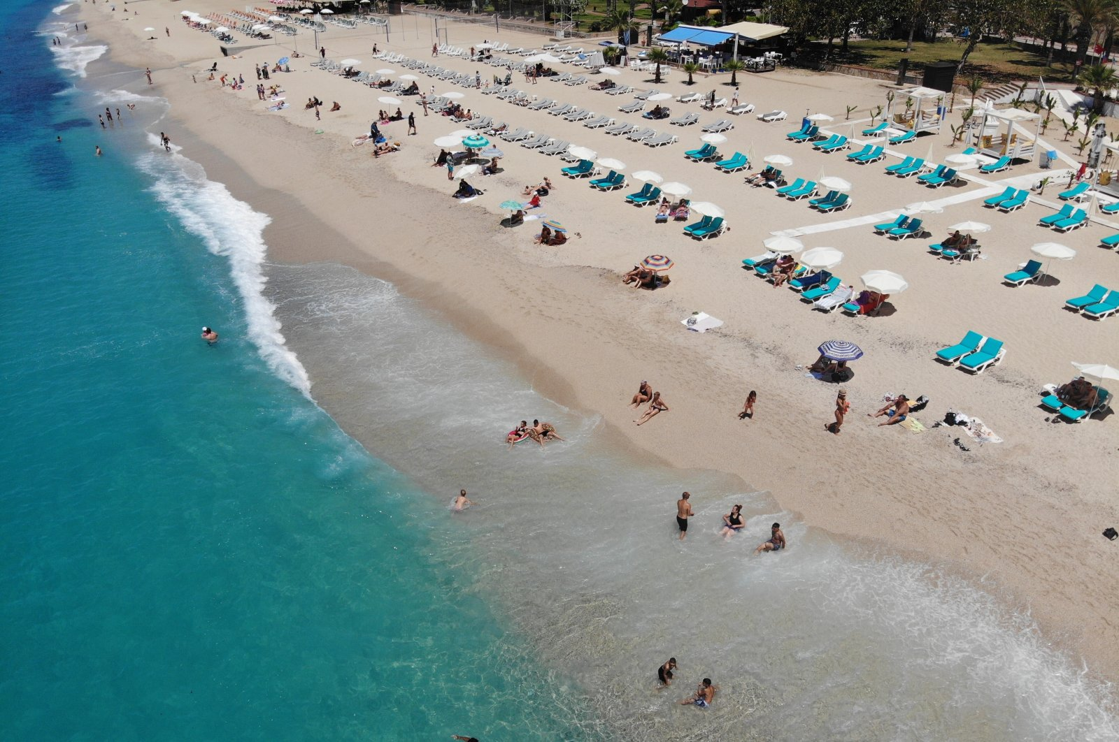An aerial view of tourists sunbathing and swimming on a beach in Antalya, southern Turkey, May 14, 2021. (IHA Photo)