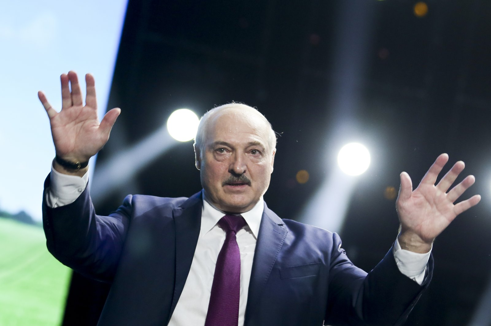 Belarusian President Alexander Lukashenko gestures as he addresses a women's forum in Minsk, Belarus, Sept. 17, 2020. (TUT.by via AP)