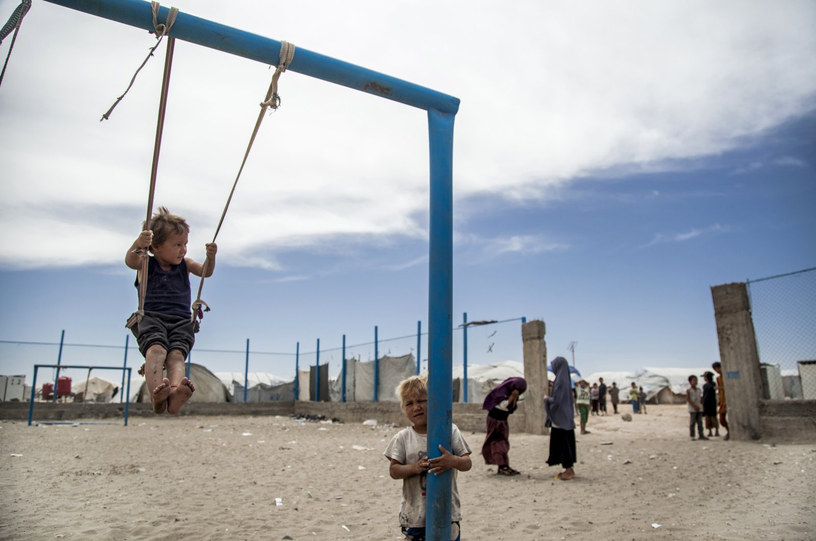 Children play at the al-Hol camp, which houses some 70,000 refugees, including families and supporters of the Daesh terrorist group, many of them foreign nationals, in Hassakeh province, Syria, May 1, 2021. (AP Photo)
