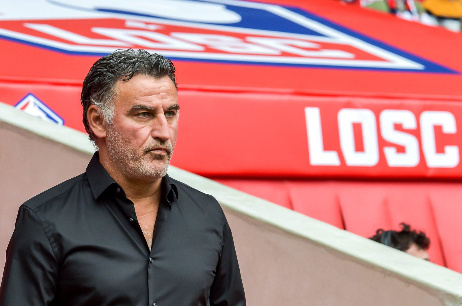 Lille's French coach Christophe Galtier looks on during the French Ligue 1 match against FC Nantes at the Pierre Mauroy Stadium, in Villeneuve-d'Ascq, northern France, Aug. 11, 2019.