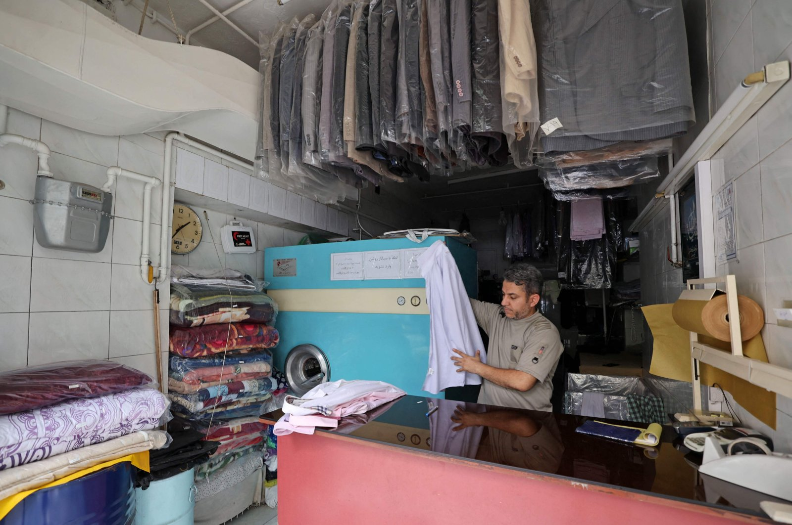 An employee sorts laundry during a power outage in Tehran, Iran, May 23, 2021. (AFP Photo)