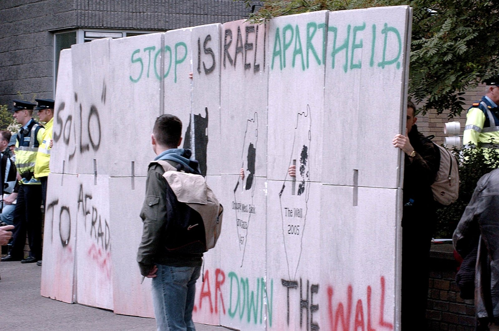 Protestors place a mock-up of the separation barrier between Israel and the occupied territories, during a demonstration outside the Israeli Embassy before the start of the World Cup qualifying soccer match between Israel and the Republic of Ireland, in Dublin, Ireland, June 4, 2005. (AP Photo)