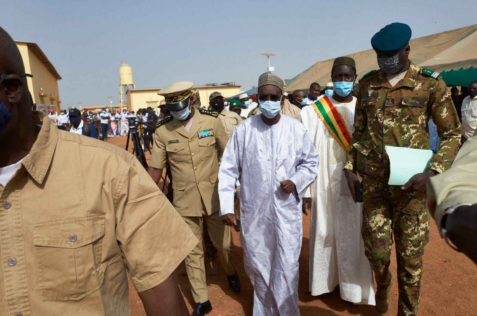 Malian Prime Minister Moctar Ouane and his delegation attend the inauguration of the new river port of Konna in central Mali, March 20, 2021. (AFP Photo)