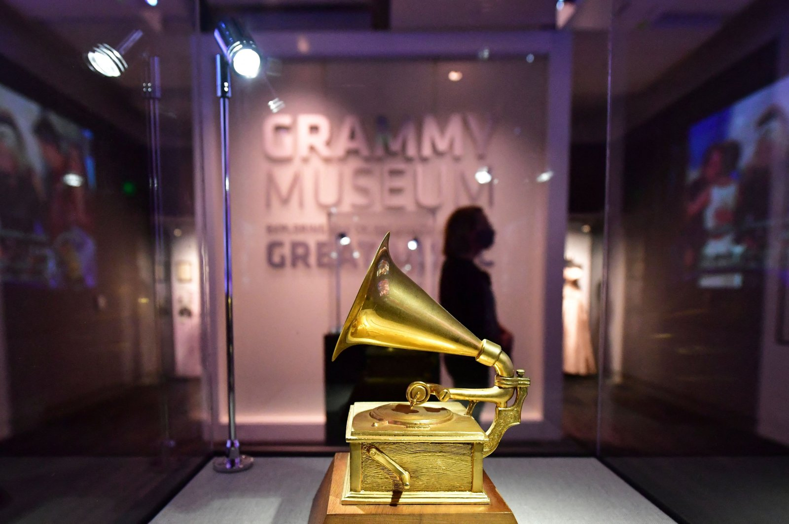 People visit the Grammy Museum on the first day of its reopening in Los Angeles, more than a year after the museum closed due to the global COVID-19 pandemic, Los Angeles, U.S., May 21, 2021. (AFP Photo)