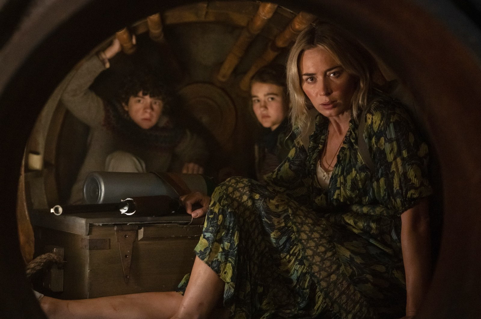"""Actors Noah Jupe (L), Millicent Simmonds and Emily Blunt (R) can be seen in a scene from """"A Quiet Place Part II."""" (Paramount Pictures via AP)"""