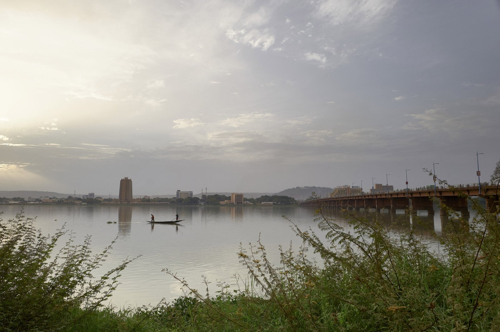 Two men fish in the Niger River by the Martyrs Bridge, in Bamako, Niger, on May 25, 2021. (AFP Photo)