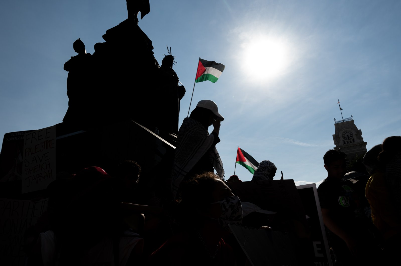 People listen to speakers and hold signs during a pro-Palestine protest on the steps of City Hall in Louisville, Kentucky, U.S., May 23, 2021. (AFP Photo)