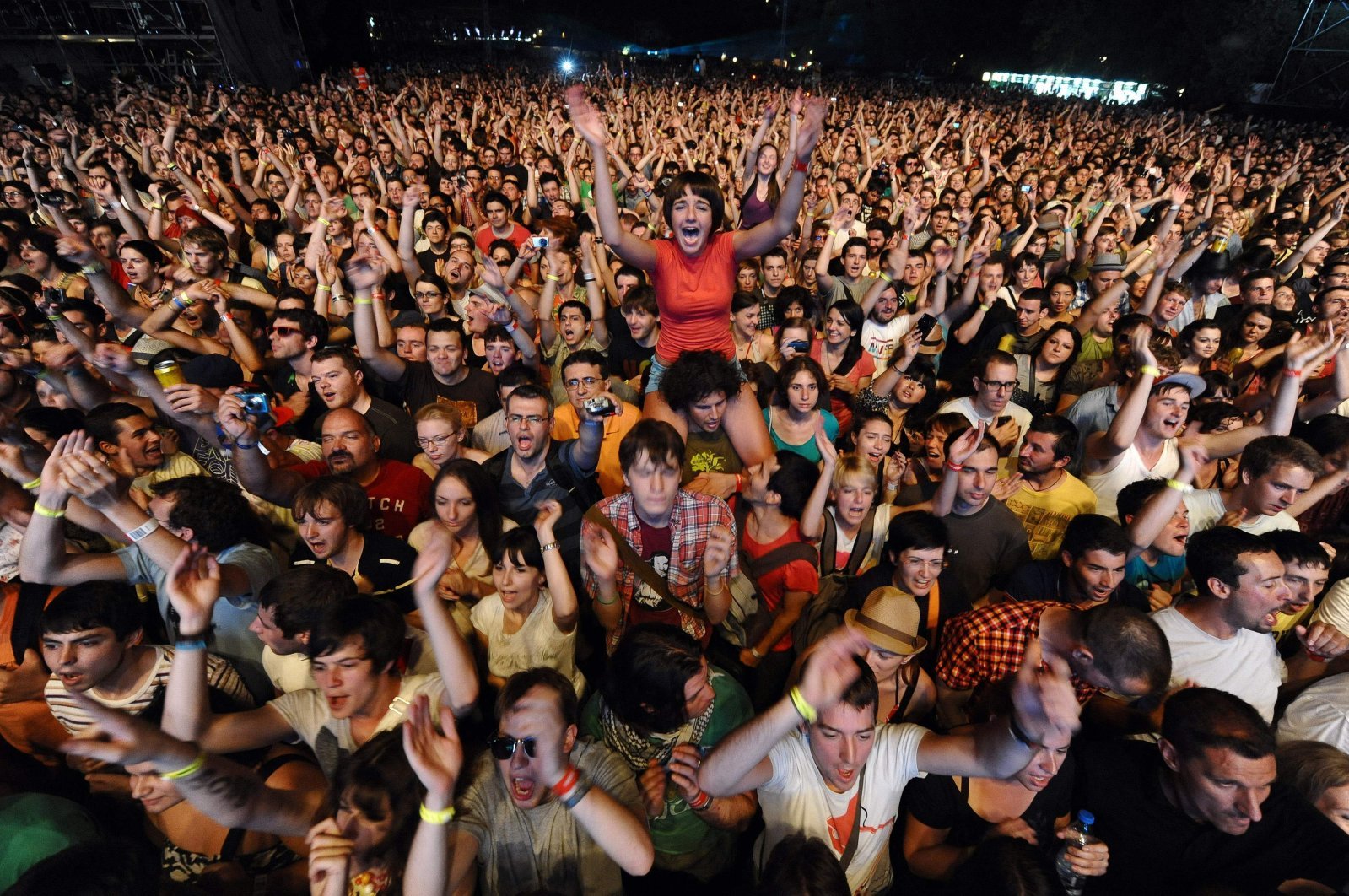 Festival-goers cheer during a concert at the EXIT music festival near Novi Sad, Serbia, July 7, 2011. (AFP File Photo)